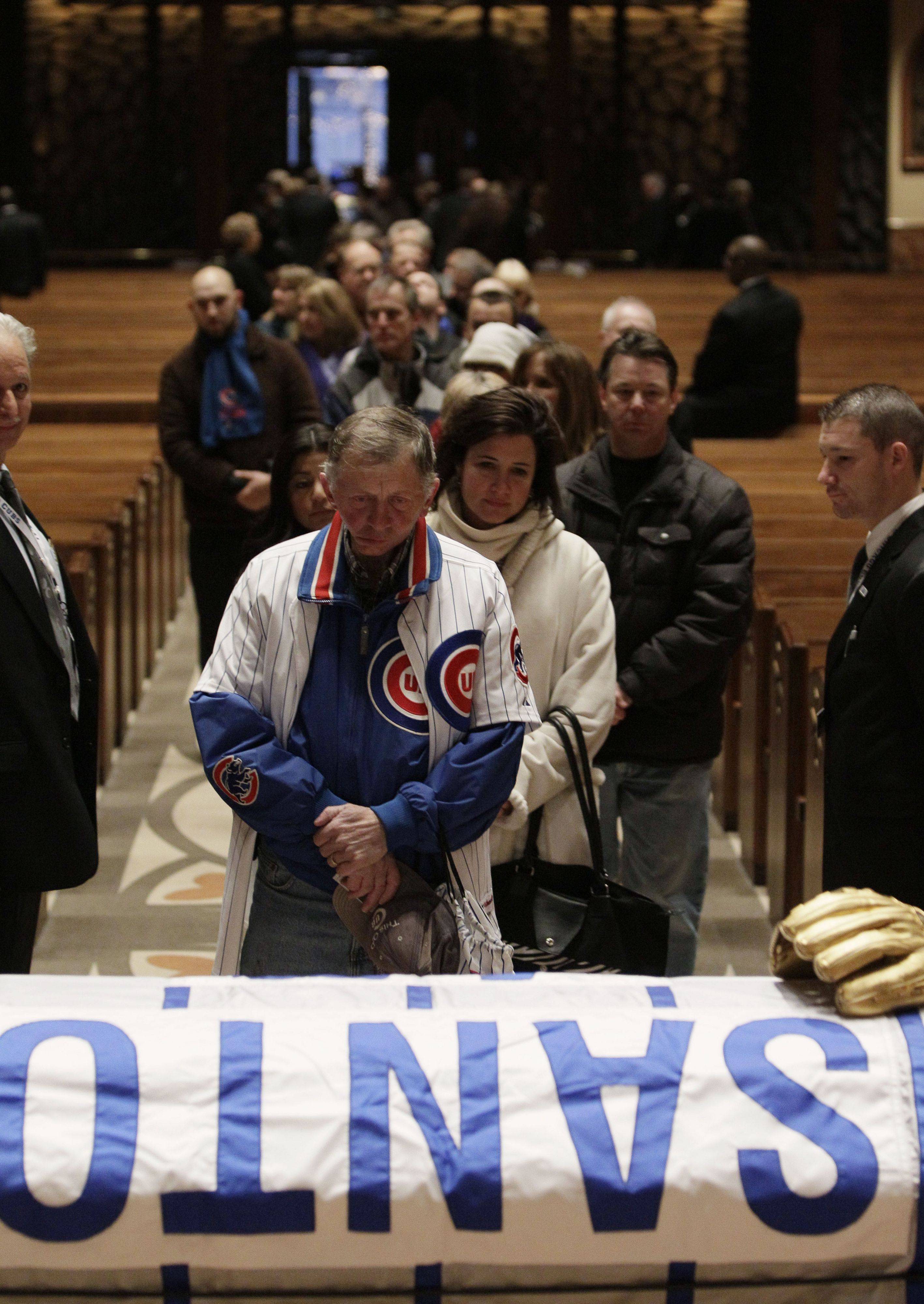 Cubs fans line up Thursday during the visitation service for Cubs great and longtime radio announcer Ron Santo at Holy Name Cathedral in Chicago. For more photos from the visitation, go to dailyherald.com