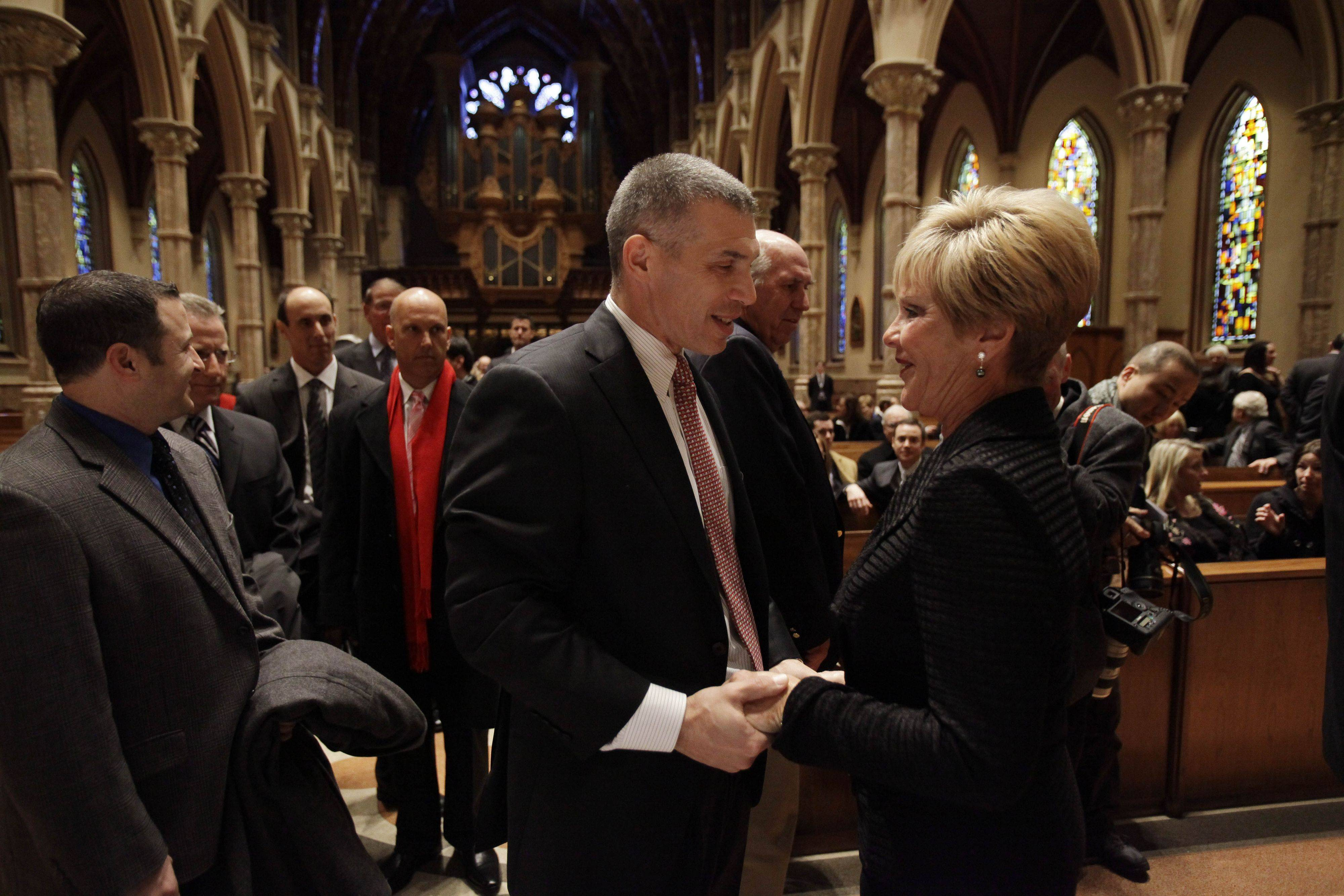 New York Yankees manager Joe Girardi talks to Vicki Santo, wife of Chicago Cubs great and longtime radio announcer Ron Santo, during the visitation at Holy Name Cathedral Thursday, Dec. 9, 2010, in Chicago. The nine-time all-star died Thursday, Dec. 2, 2010 in an Arizona hospital from complication of bladder cancer. He was 70. (AP Photo/Nam Y. Huh, Pool)
