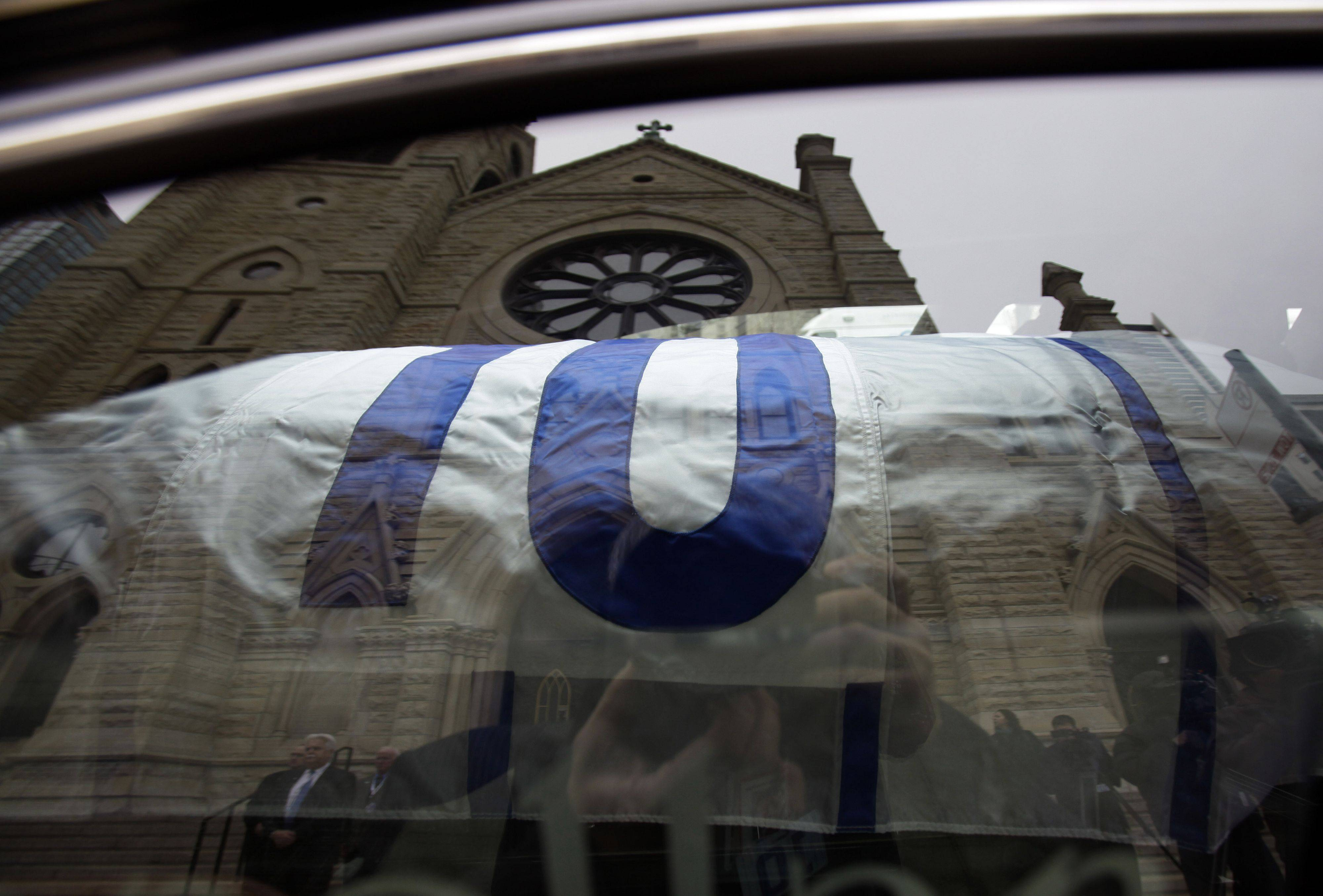 Casket arrives at Holy Name Cathedral, reflected on the window, for the visitation of Chicago Cubs great and longtime radio announcer Ron Santo at Holy Name Cathedral, Thursday, Dec. 9, 2010, in Chicago. The nine-time all-star died Thursday, Dec. 2 in an Arizona hospital from complication of bladder cancer. He was 70. (AP Photo/Nam Y. Huh, Pool)