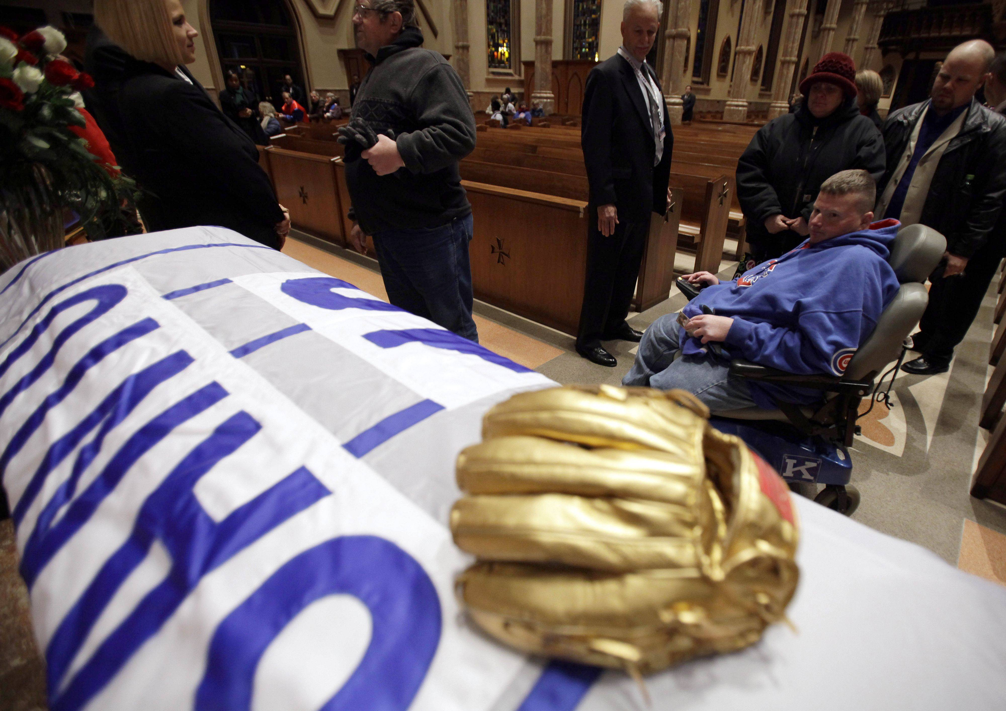 Chicago Cubs fans line up during the visitation for Chicago Cubs great and longtime radio announcer Ron Santo at Holy Name Cathedral, Thursday, Dec. 9, 2010, in Chicago. The nine-time all-star died Thursday, Dec. 2 in an Arizona hospital from complication of bladder cancer. He was 70. (AP Photo/Nam Y. Huh, Pool)
