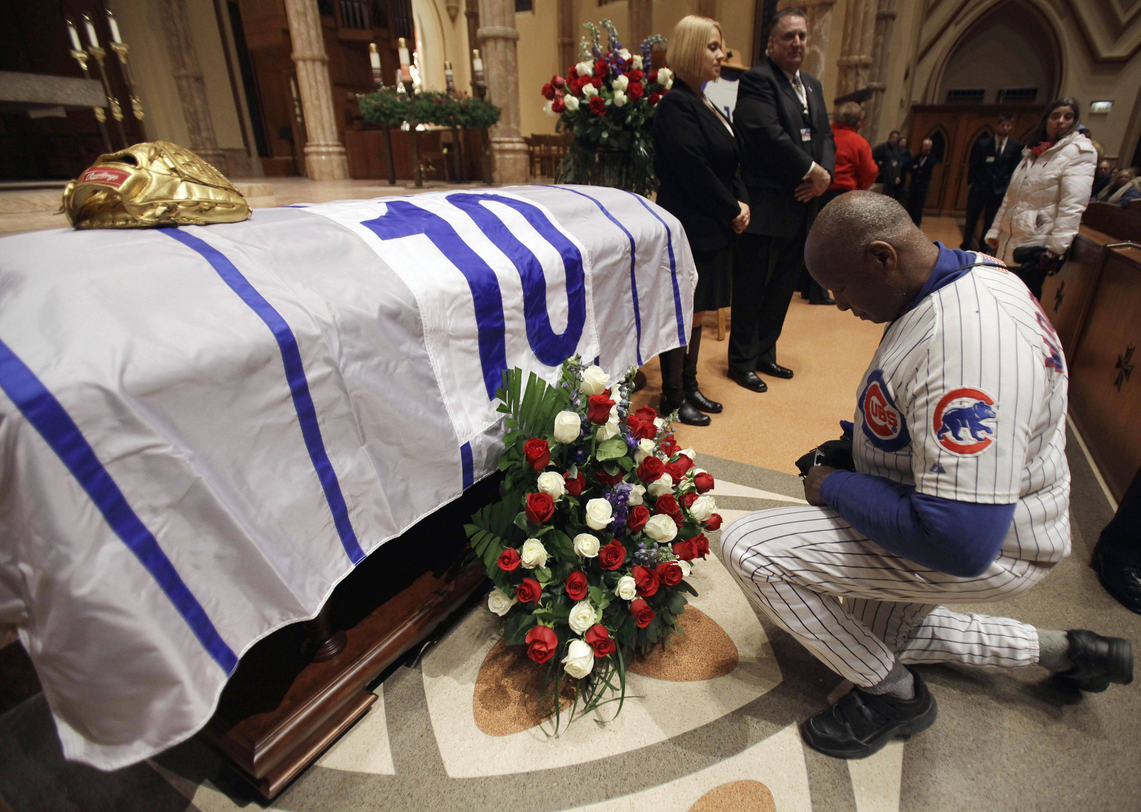 Woo-Woo, right, prays during the visitation for Chicago Cubs great and longtime radio announcer Ron Santo at Holy Name Cathedral, Thursday, Dec. 9, 2010, in Chicago. The nine-time all-star died Thursday, Dec. 2 in an Arizona hospital from complication of bladder cancer. He was 70. (AP Photo/Nam Y. Huh, Pool)