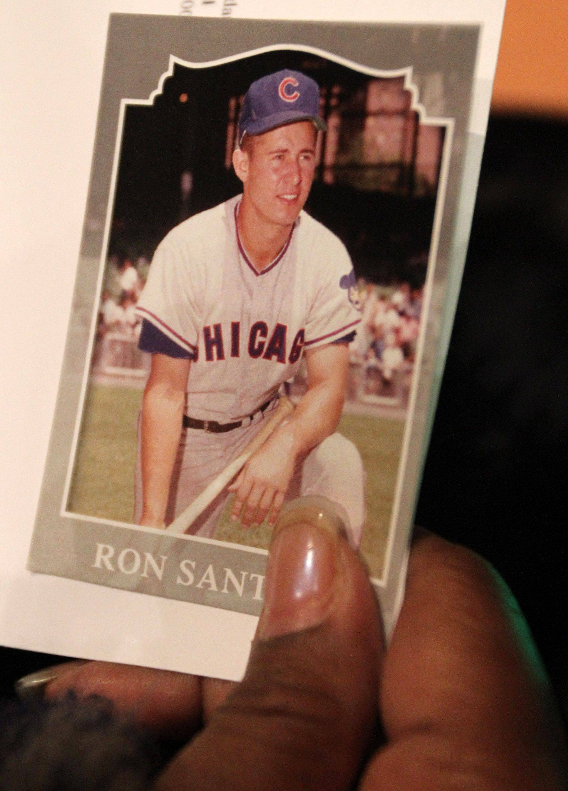 Chicago Cubs fan Babette Peyton of Chicago holds a Ron Santo baseball card given to her at the public visitation for Chicago Cubs legend Ron Santo.