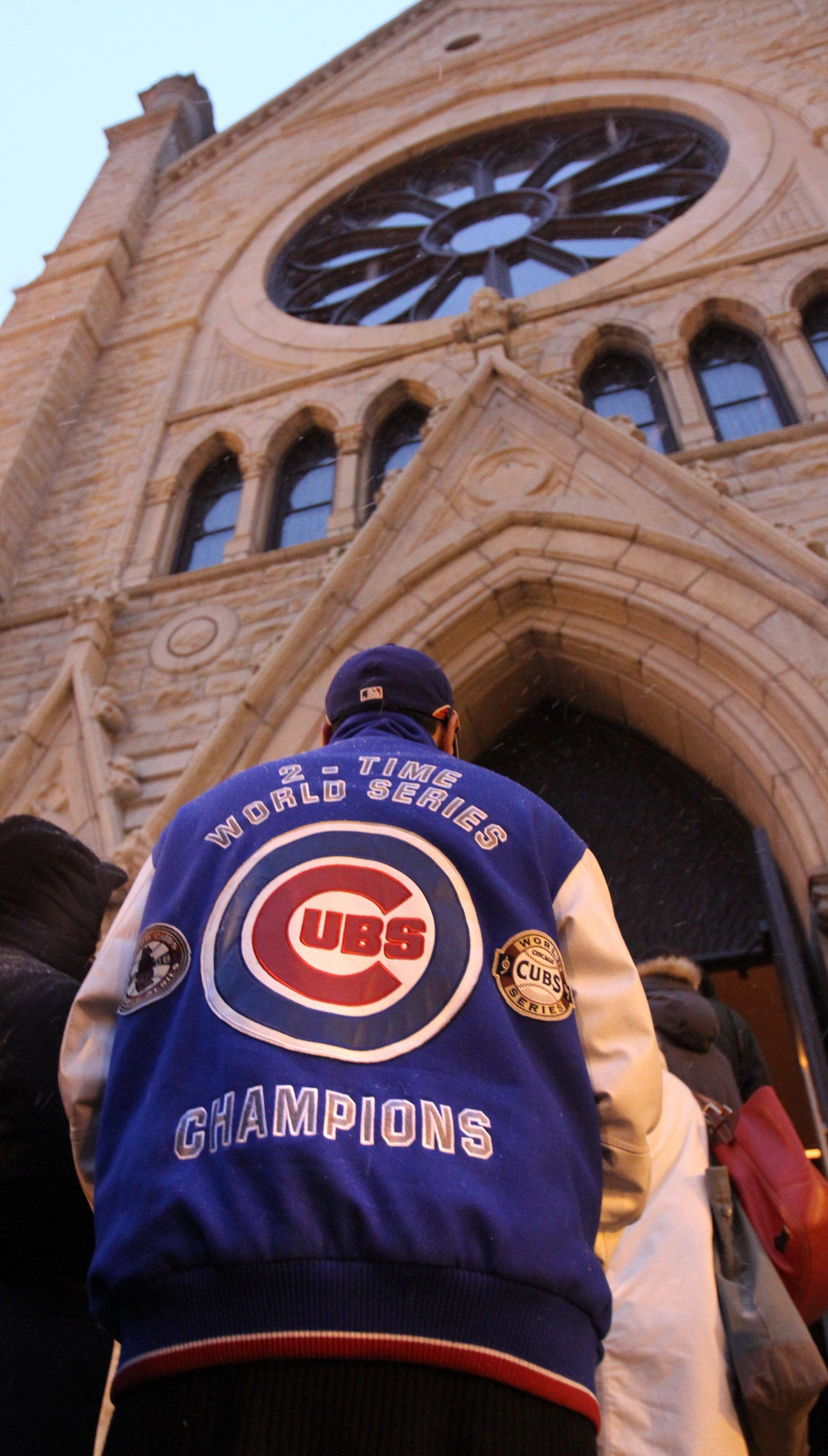 Chicago Cubs fans waited in line for one block on State Street for the public visitation for Chicago Cubs legend Ron Santo at Holy Name Cathedral.