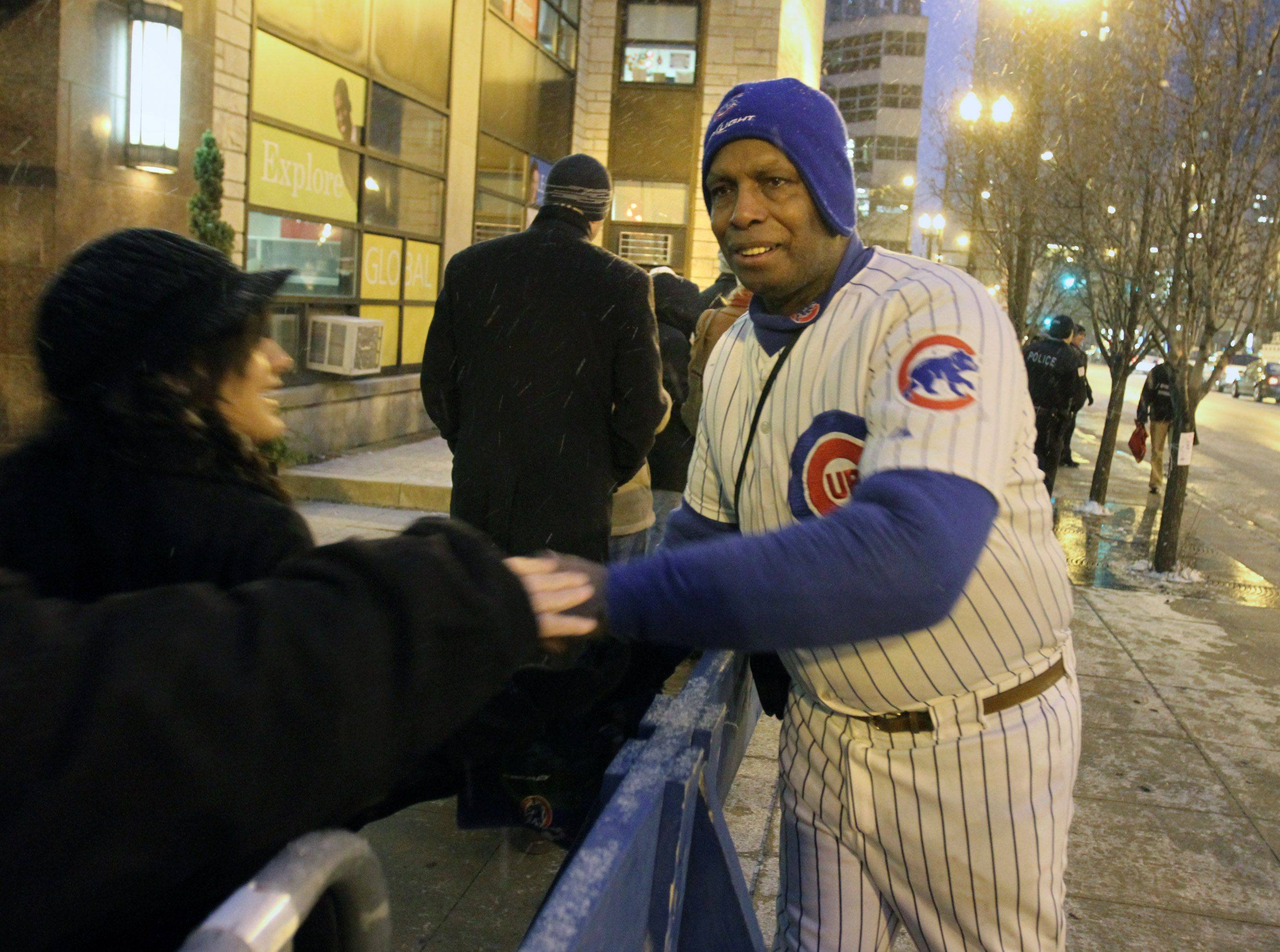 Ronnie Woo-Woo greets Chicago Cubs fans on State Street.