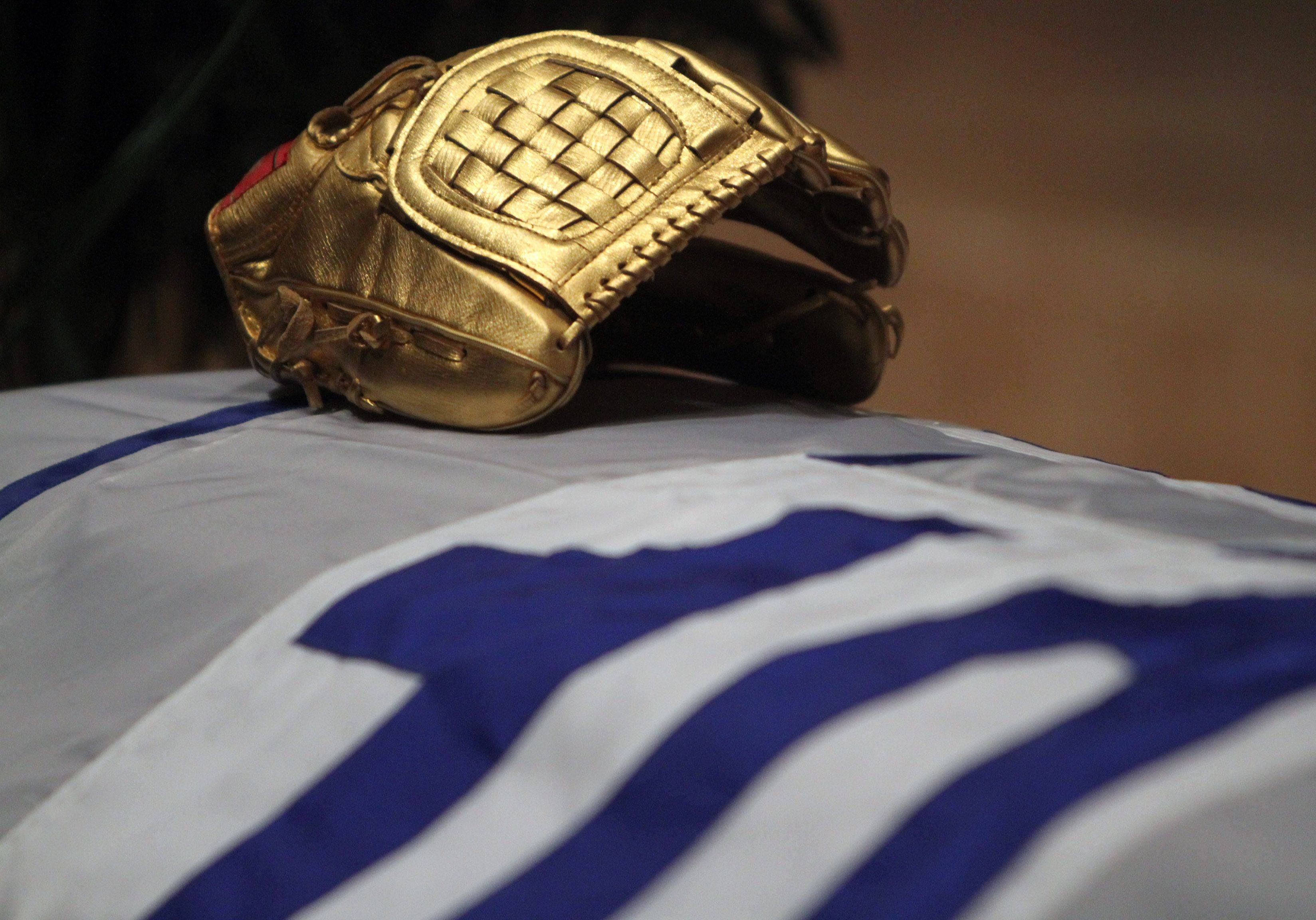 A Ron Santo gold glove rests on his casket at Holy Name Cathedral.