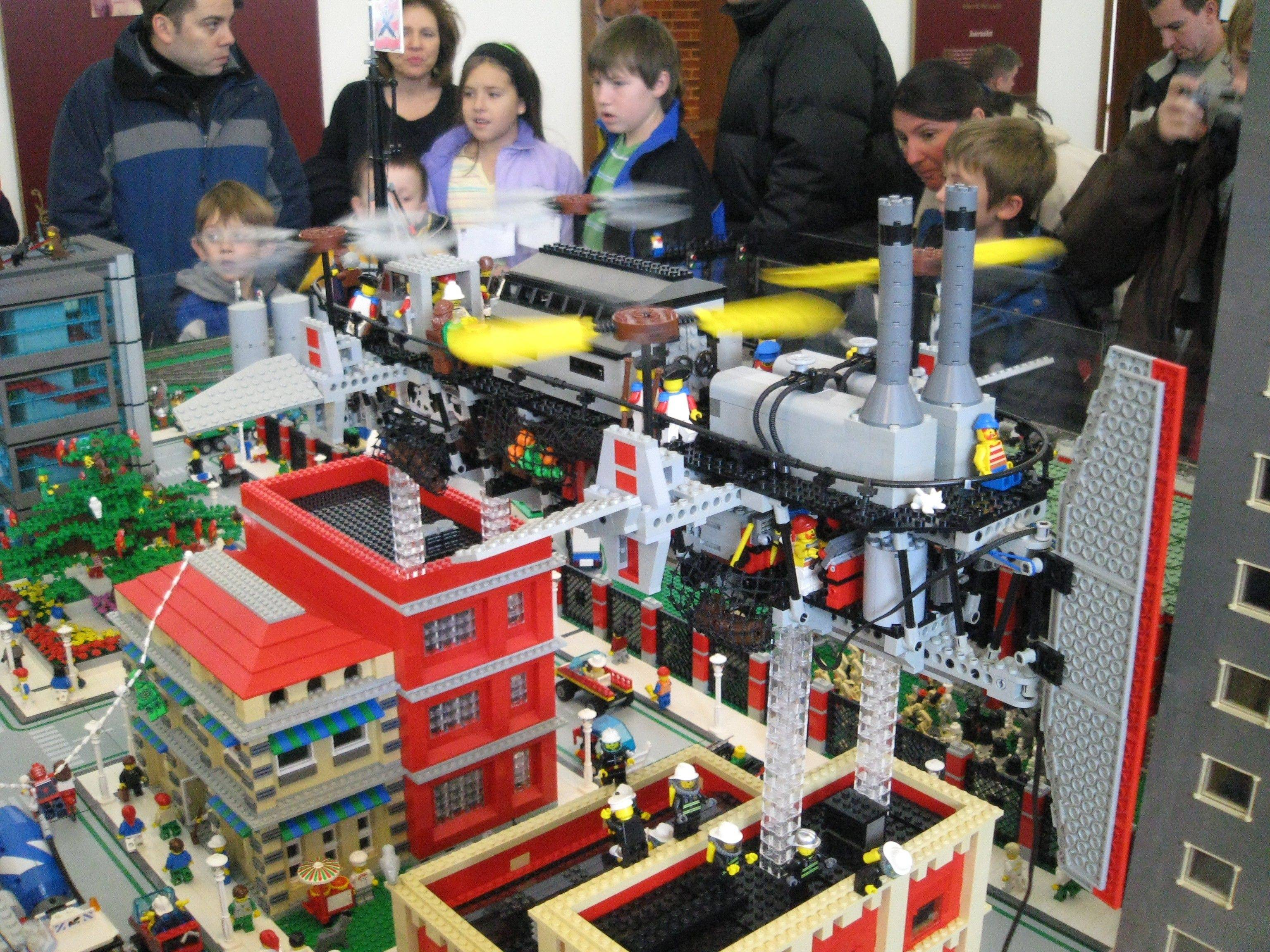 As model trains chug past, visitors can explore a Lego world  complete with bustling cities  created by the Northern Illinois Lego Train Club.