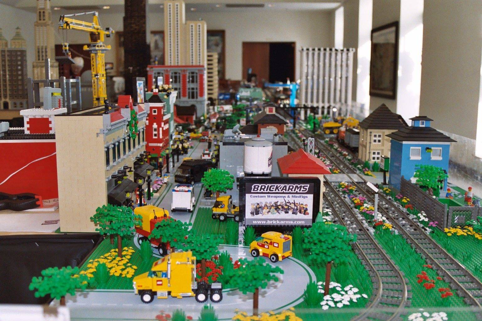 The Northern Illinois Lego Train Club's locomotives roll past everything from buildings and vehicles to trees and flowers  all made from Legos.