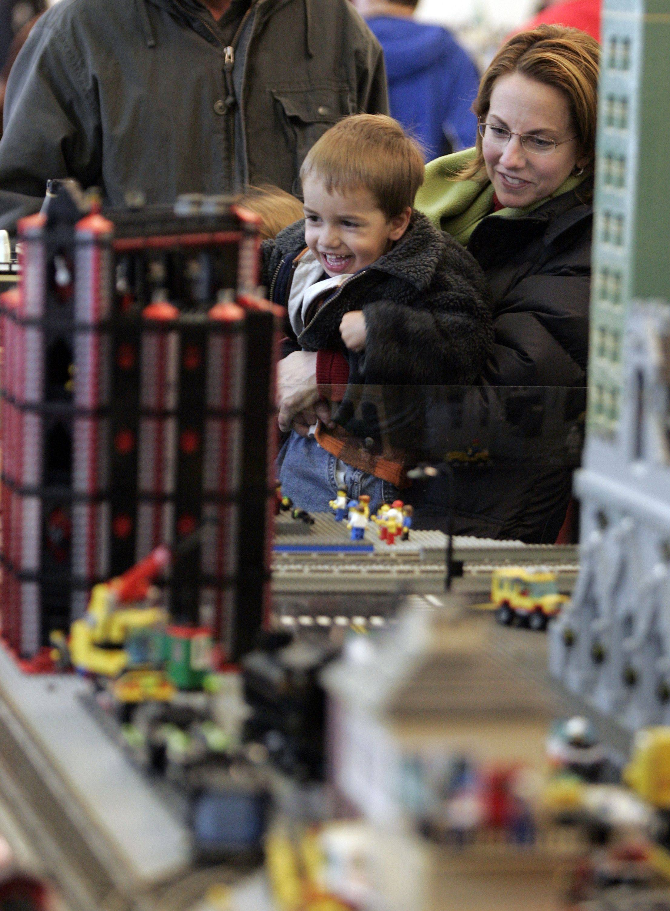 While children might just be happy to see the Legos and trains, adults are sure to find something humorous in the plastic brick world the Northern Illinois Lego Train Club creates.