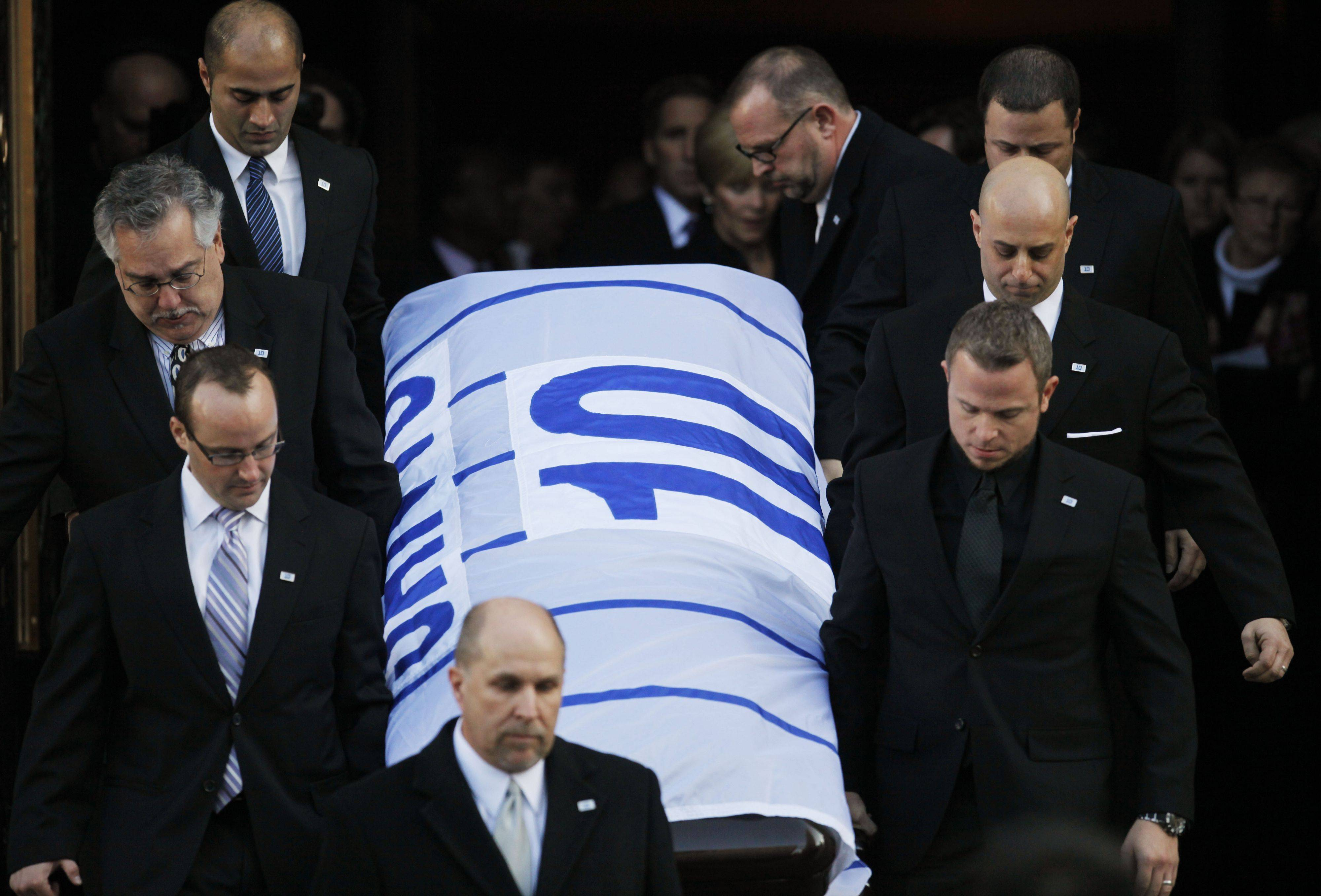 Pallbearers remove the casket of Ron Santo from Holy Name Cathedral after funeral services on Friday.