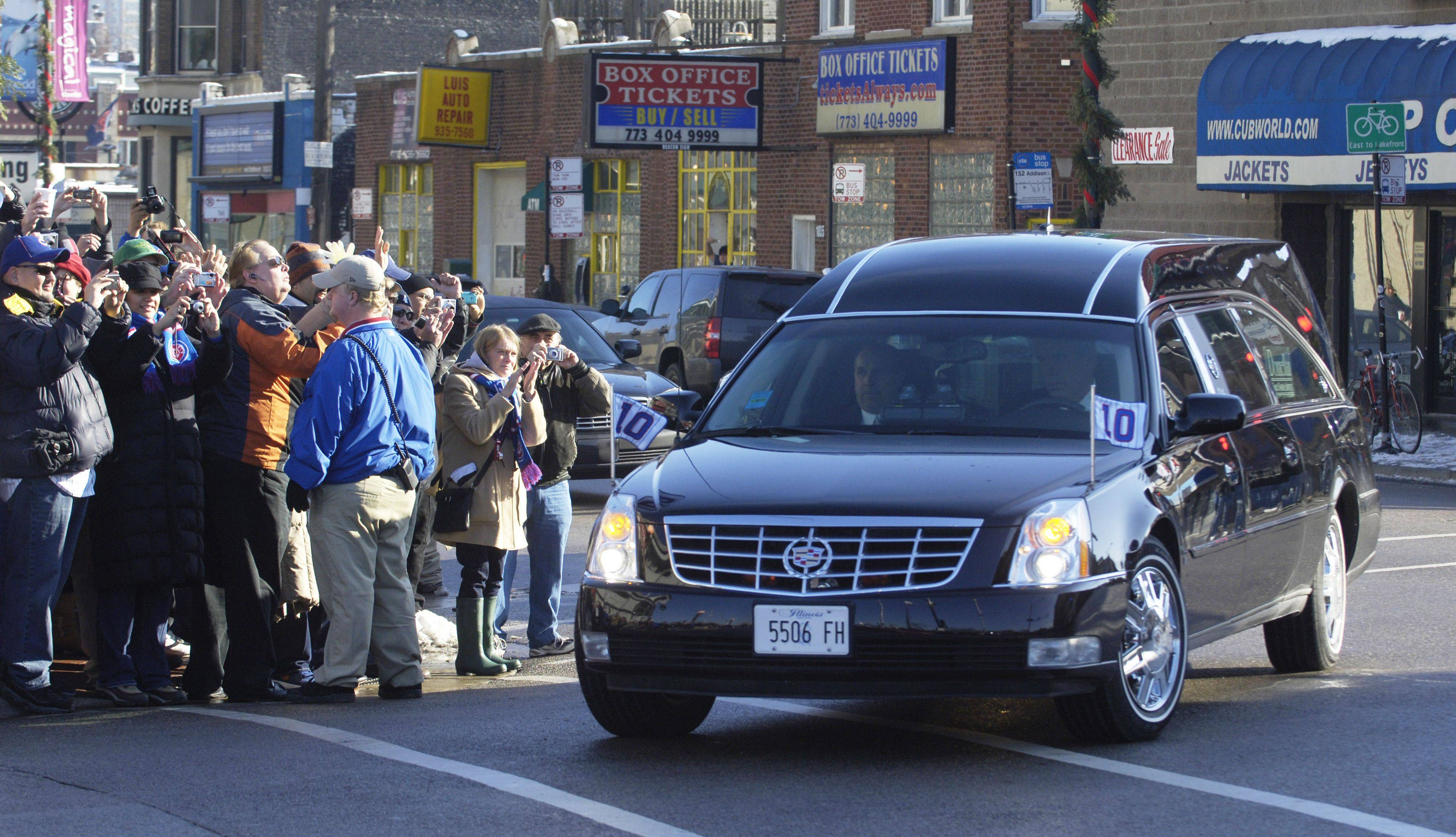 Ron Santo's funeral procession turns onto Clark Street as it passes Wrigley Field Friday.