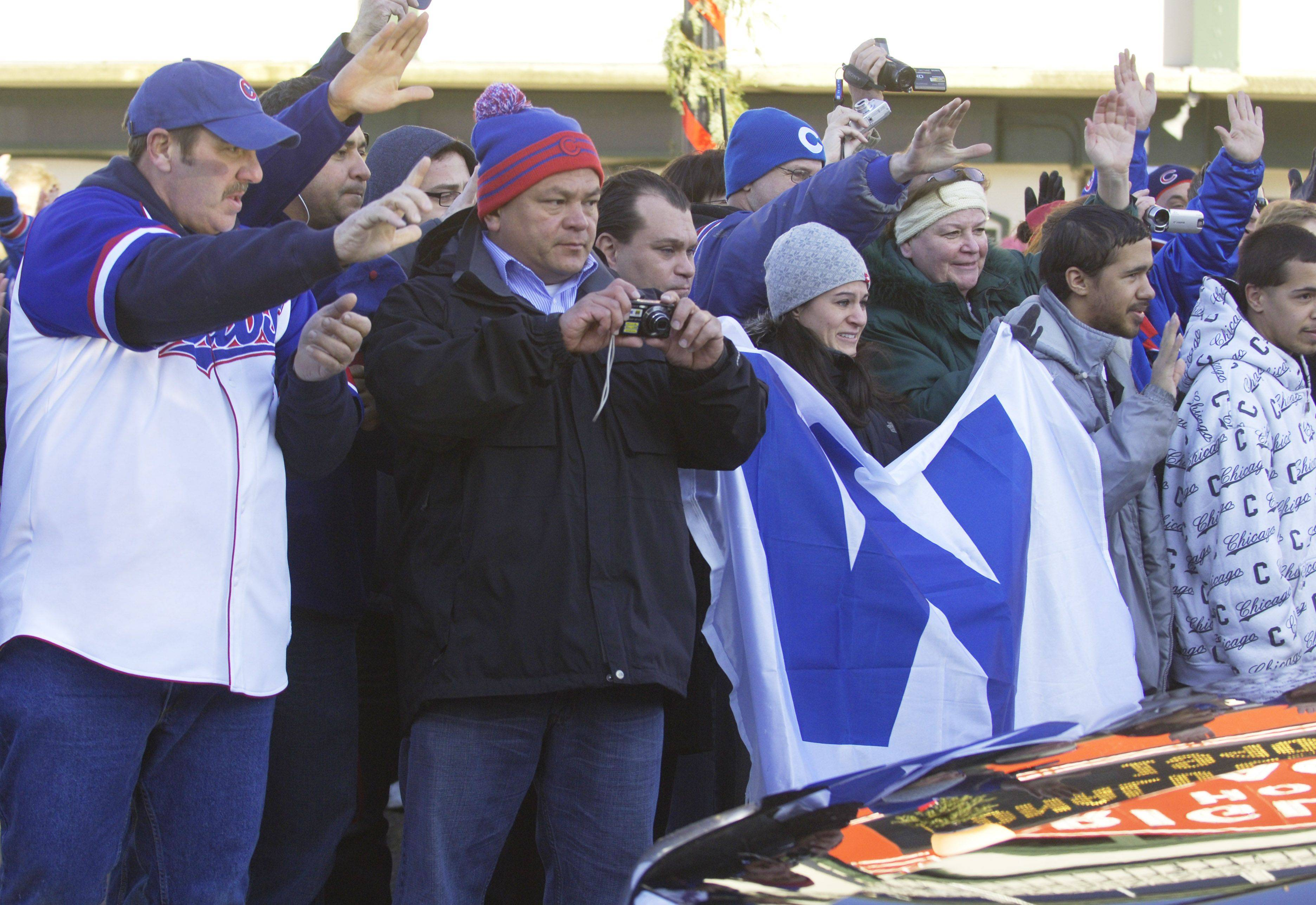 Fans watch Ron Santo's funeral procession pass Wrigley Field Friday.