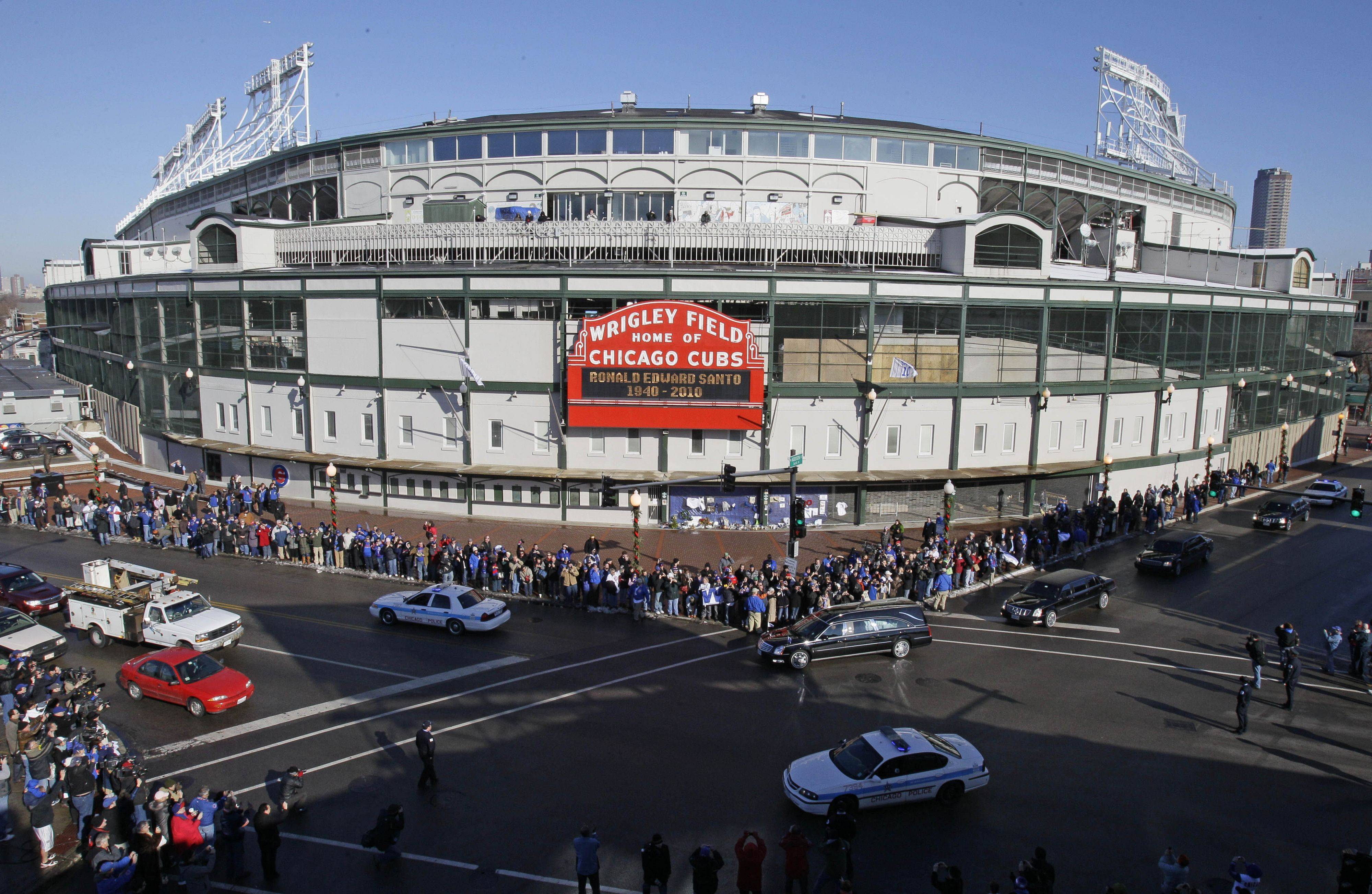 The funeral procession for Ron Santo drives past Wrigley Field.