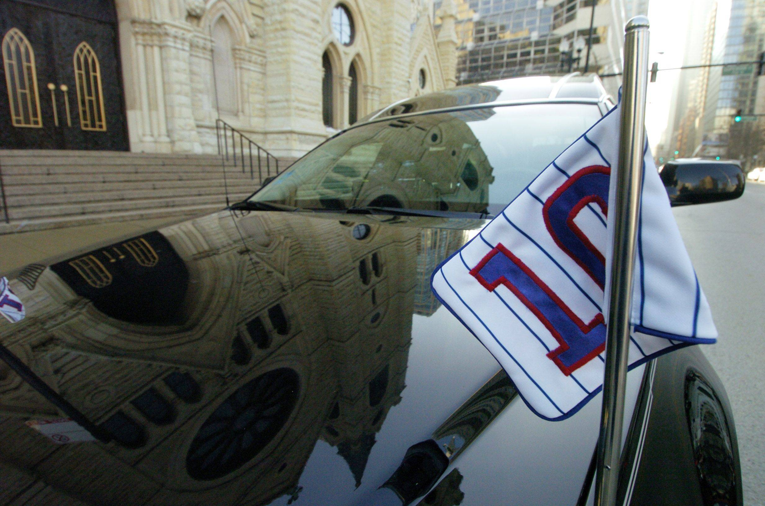 Number 10 flags adorn the hearse during Ron Santo's funeral at Holy Name Cathedral in Chicago on Friday.