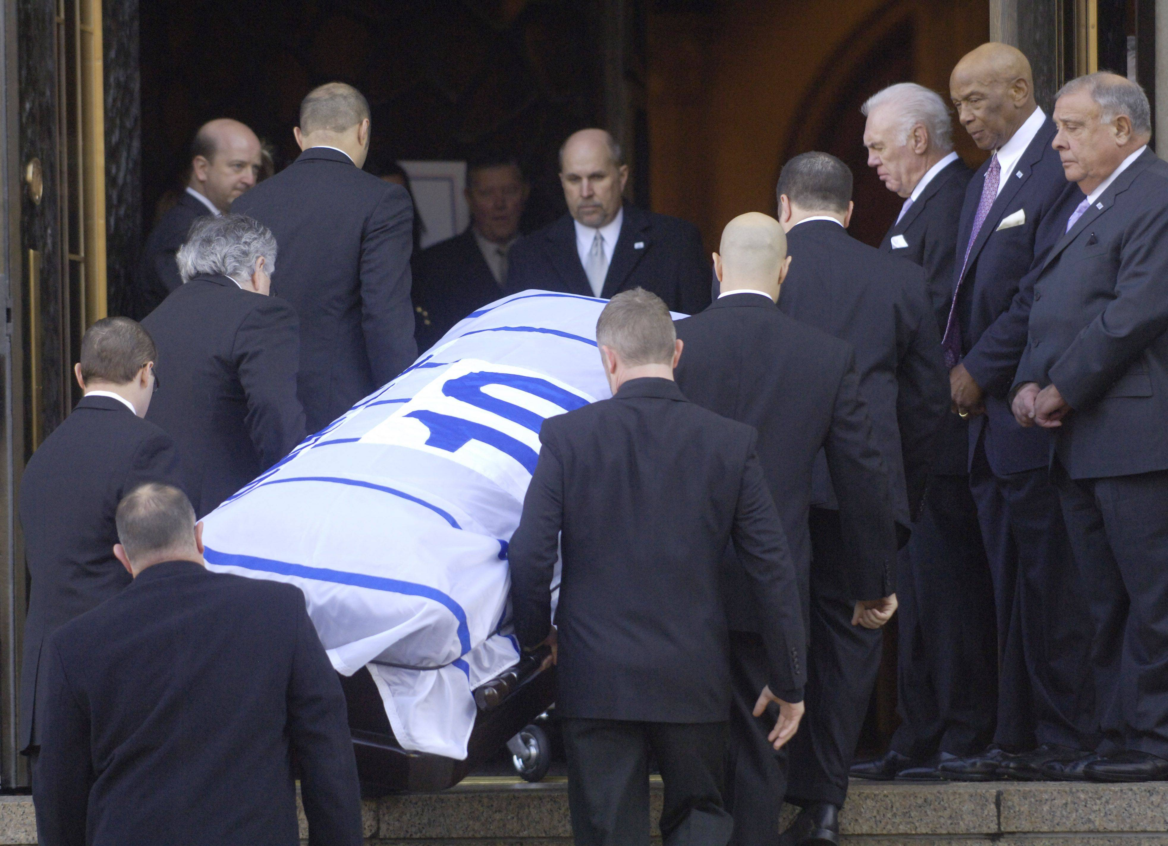 Pallbearers carry Ron Santo's casket into Holy Name Cathedral on Friday before his funeral. The funeral procession followed a path down Michigan Avenue and around Wrigley Field, where mourners gathered and left memorials to say goodbye to No. 10.