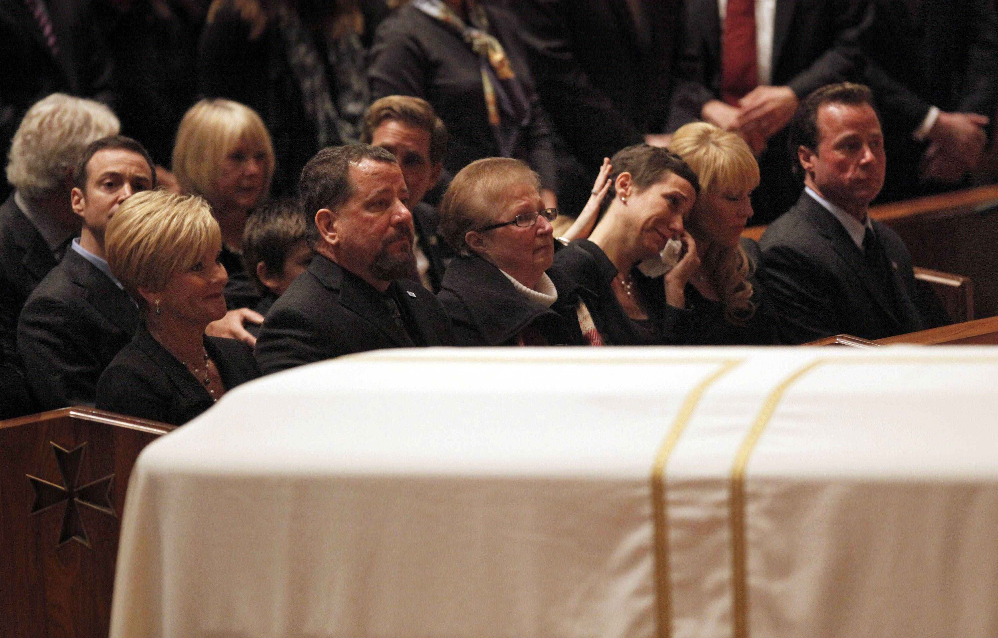 Family members react during the funeral Mass for Chicago Cubs great and longtime radio announcer Ron Santo at Holy Name Cathedral, Friday, Dec. 10, 2010 in Chicago. The nine-time all-star died Dec. 2 from complications of bladder cancer. He was 70.