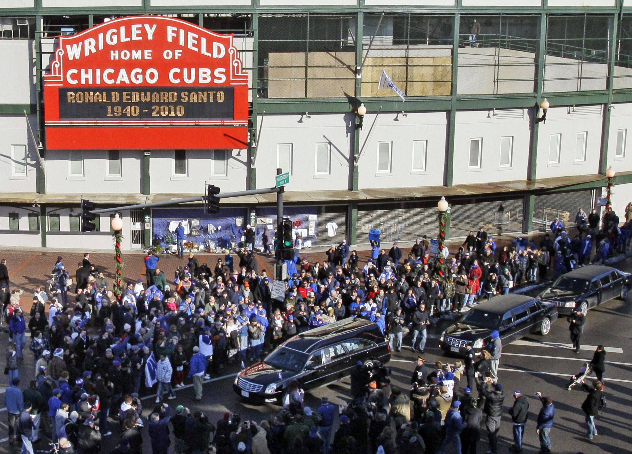 Baseball fans pay their respect as the funeral procession for former Chicago Cubs great and longtime radio announcer Ron Santo drives past Wrigley Field, Friday, Dec. 10, 2010 in Chicago. The nine-time all-star died Dec. 2 in an Arizona hospital from complications of bladder cancer. He was 70.