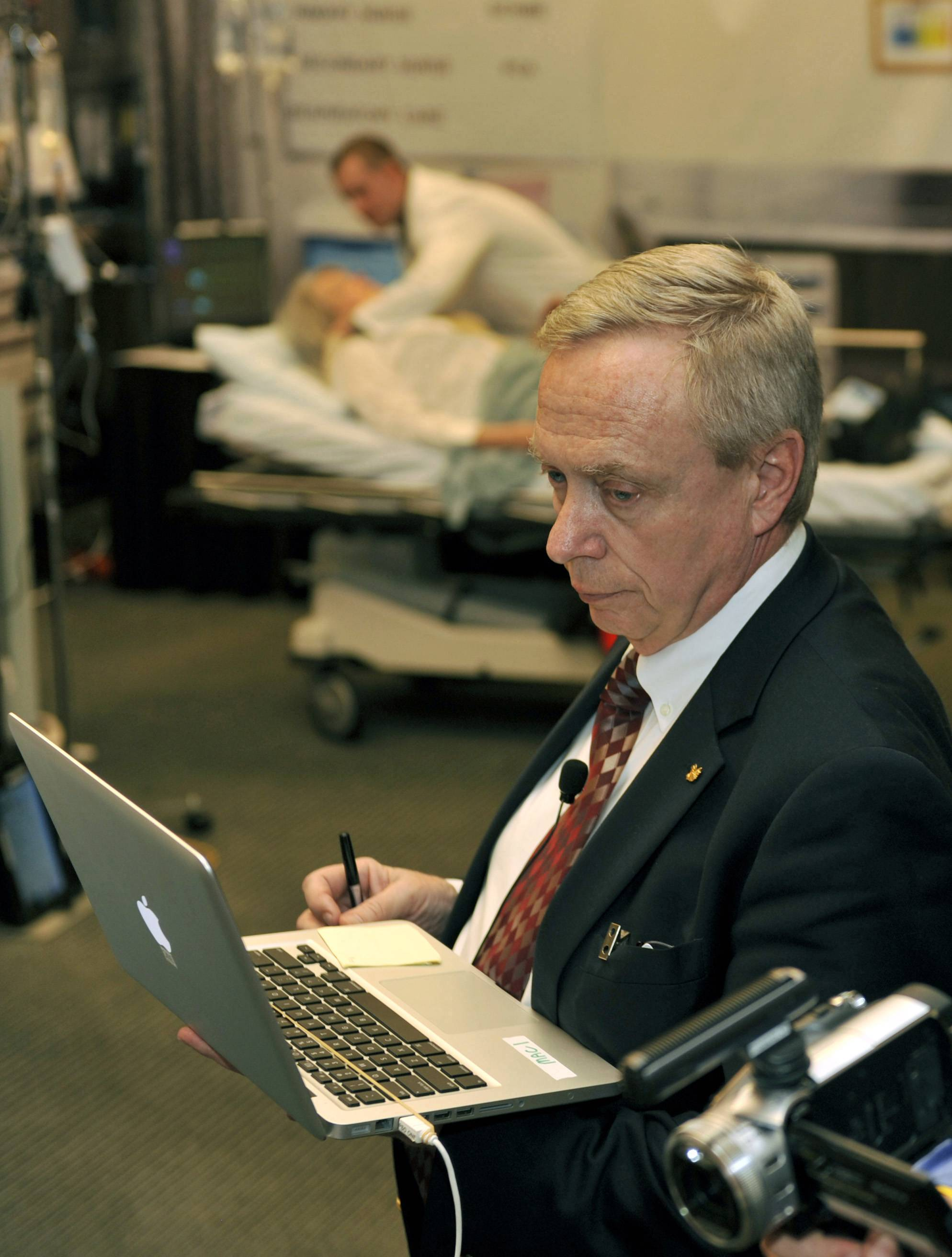 In this March 14, 2010 file photo, William Hamman watches data on a computer as he supervises doctors during a cardiology simulation at the Georgia World Congress Center in Atlanta. Hamman, an airline captain who lives in Michigan, claimed to be a cardiologist and trained other doctors in teamwork. But he never got a medical degree.