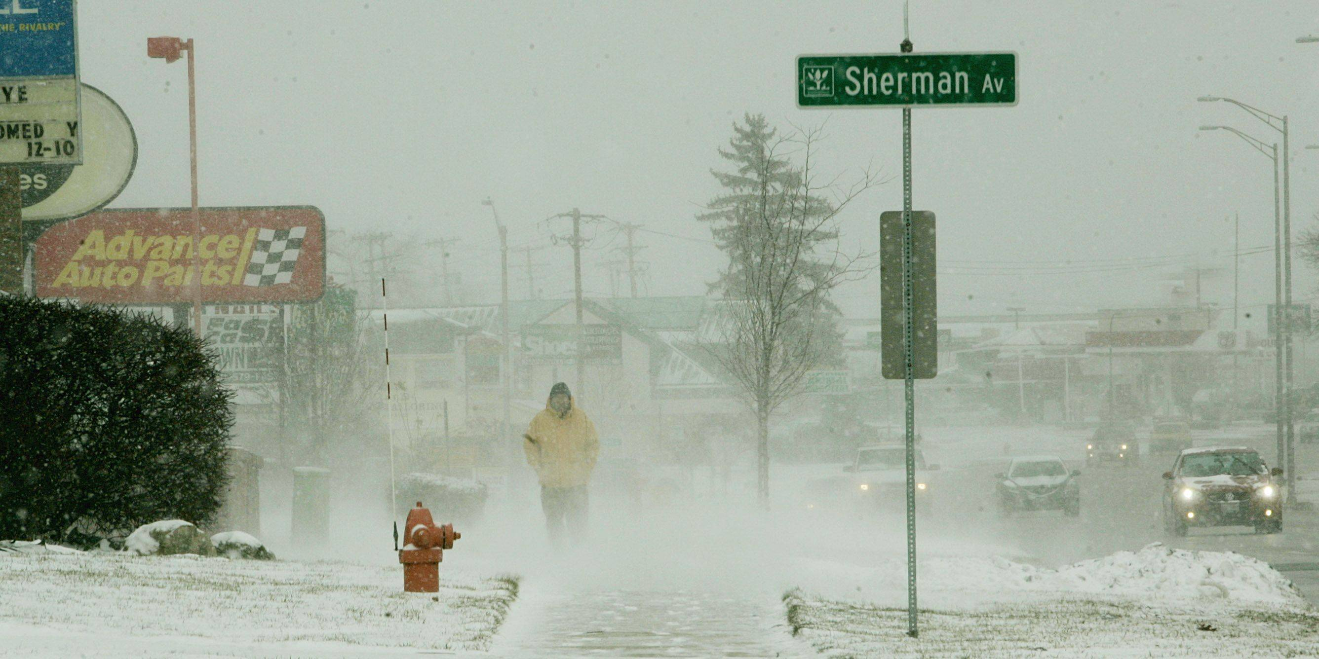 A man battles the frigid wind Sunday as he walks along Ogden Avenue in Naperville.