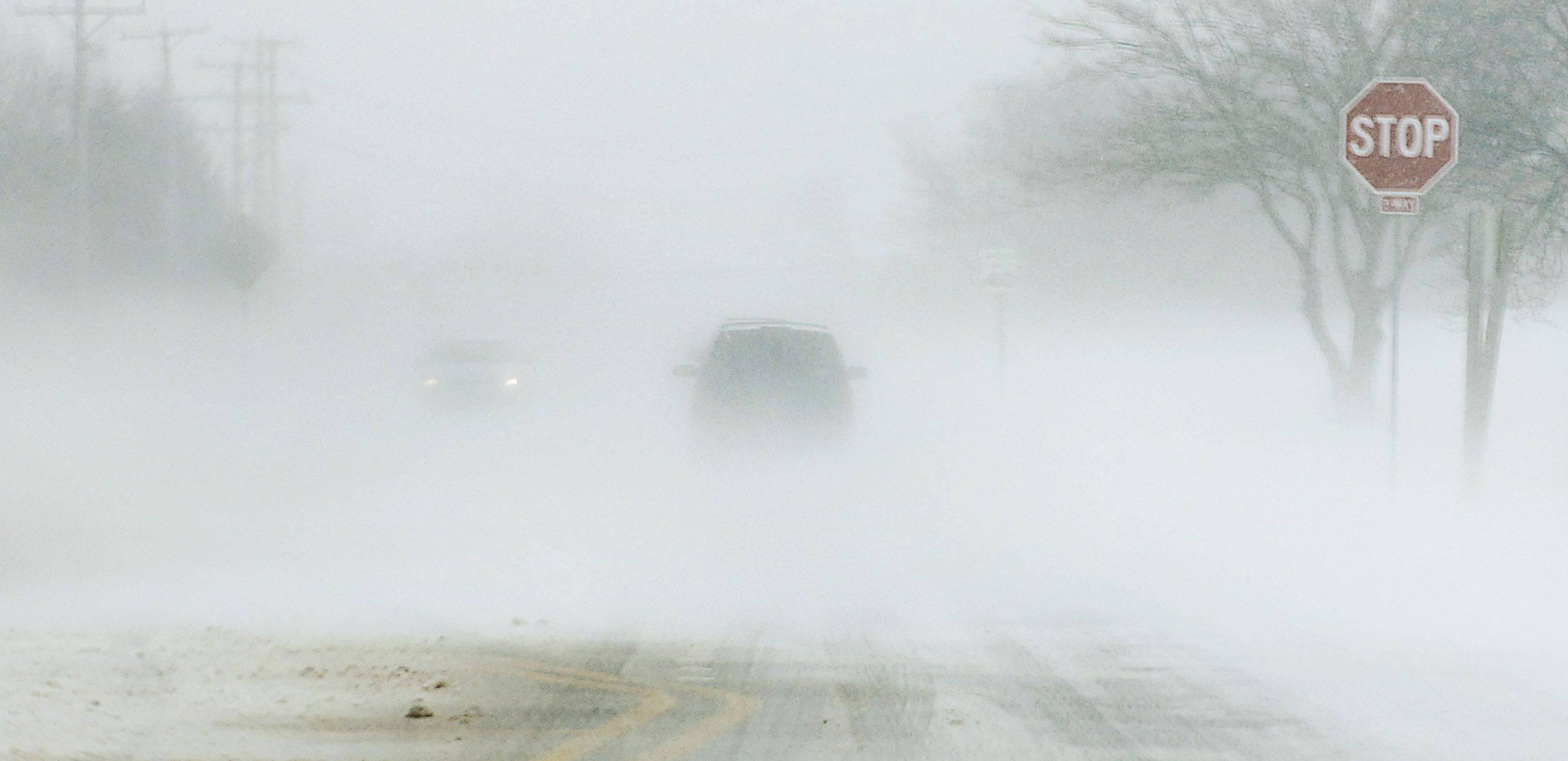 The Golf Course of Illinois presents an area for wind to bring flash whiteouts on North County Line Road in Algonquin Sunday.
