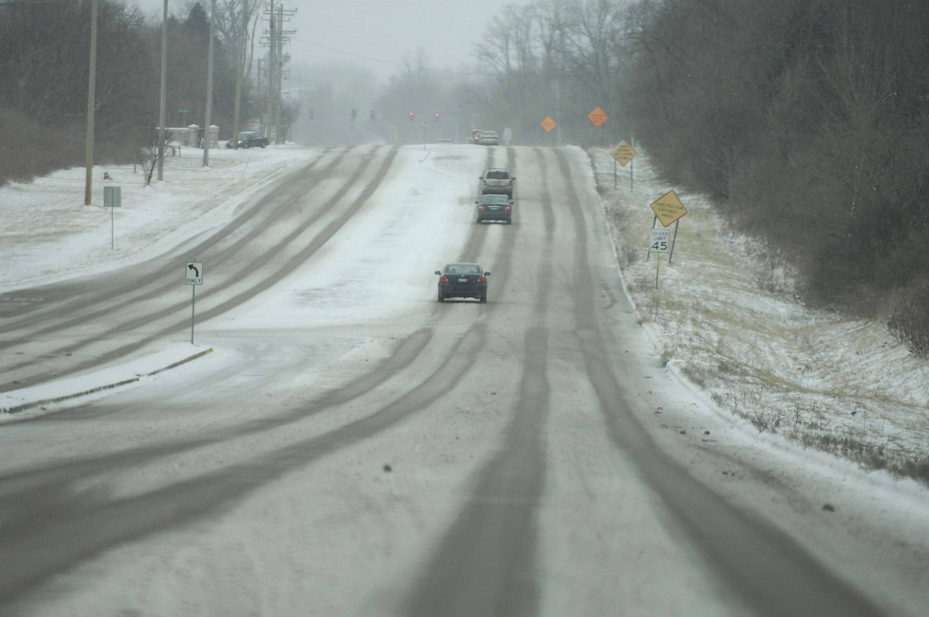 Sparse traffic moves cautiously slow on Route 25 in Carpentersville Sunday afternoon.