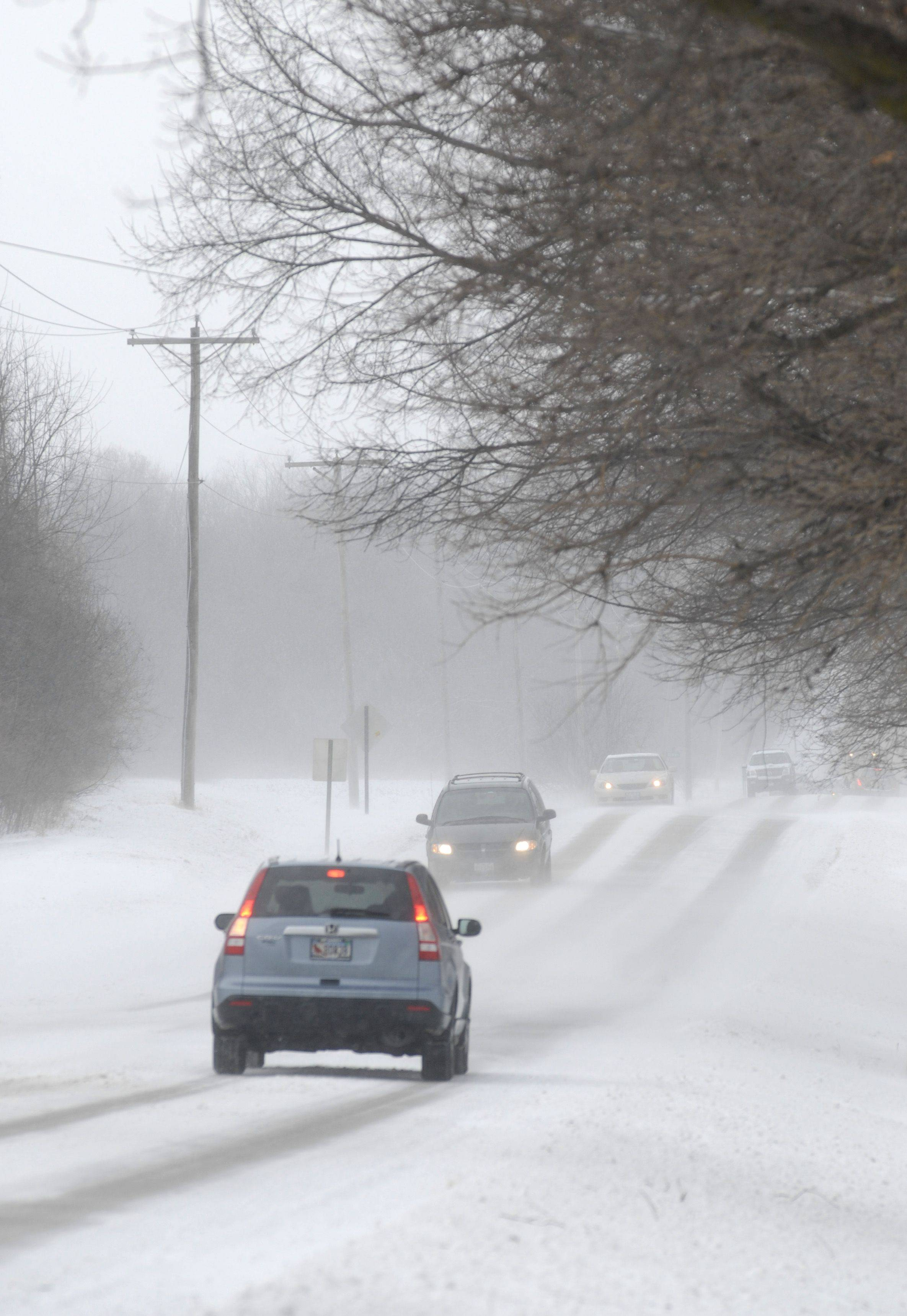 Blowing snow was creating snow drifts and reducing visibility for airline pilots and also creating a foggy haze for drivers on Dean Street in St. Charles Sunday afternoon.