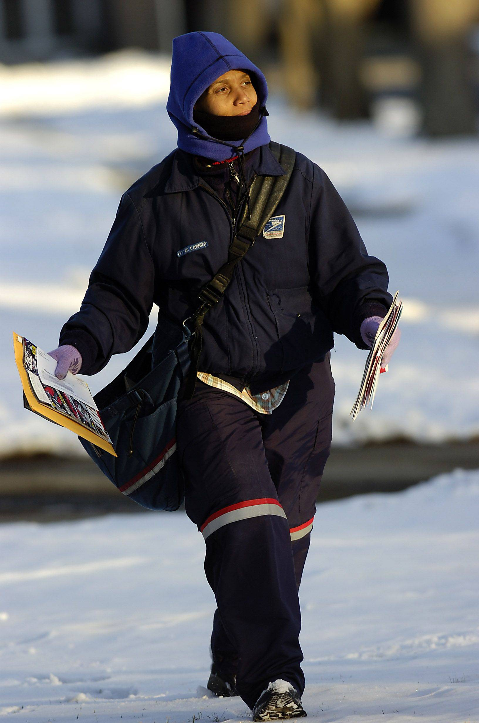 Antoinette Schaffer of Chicago delivers mail in Palatine, dressed in warm gear as she carries up to 70 pounds of mail during her route. She not only delivers the mail but also delivers smiles to all on her route with her good-natured spirit and laughter.