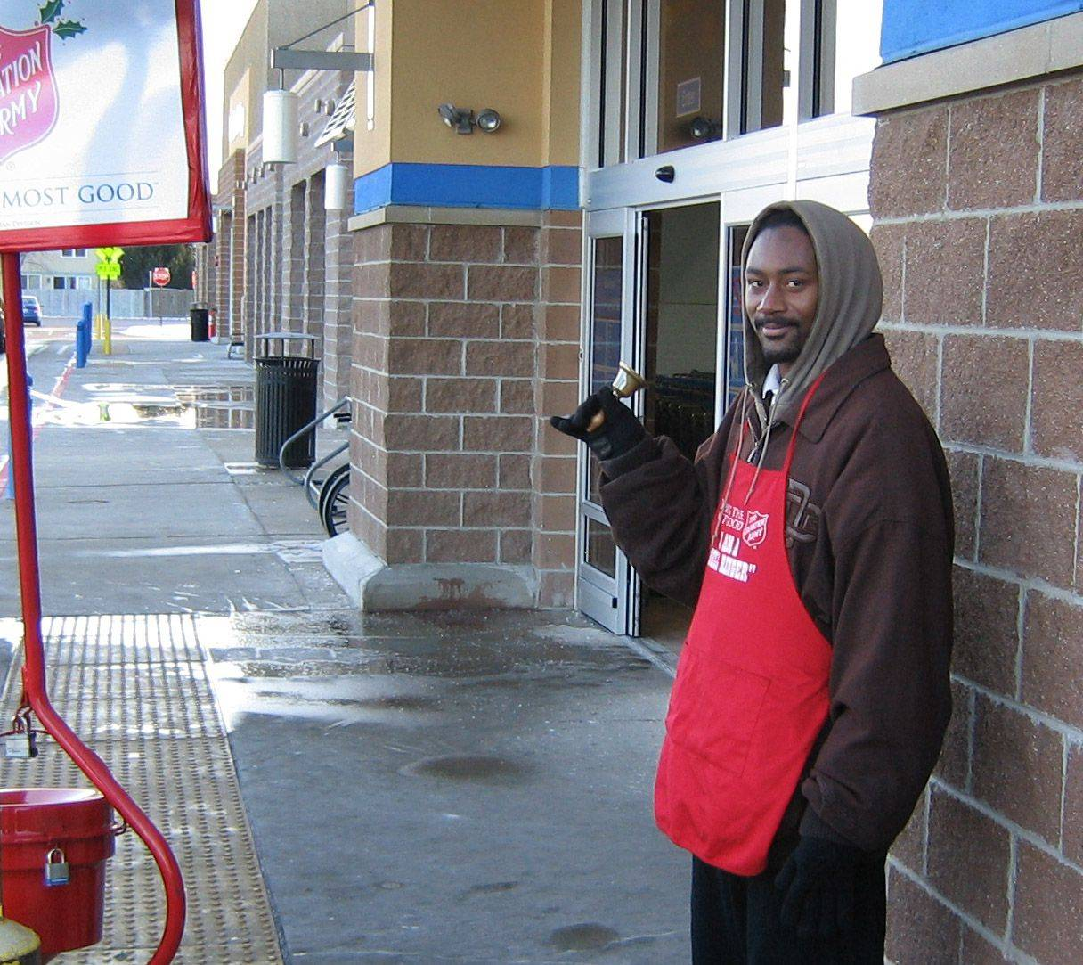 Salvation Army bell ringer Lavaughn Peoples of Waukegan works outside the Round Lake Beach Walmart Friday.