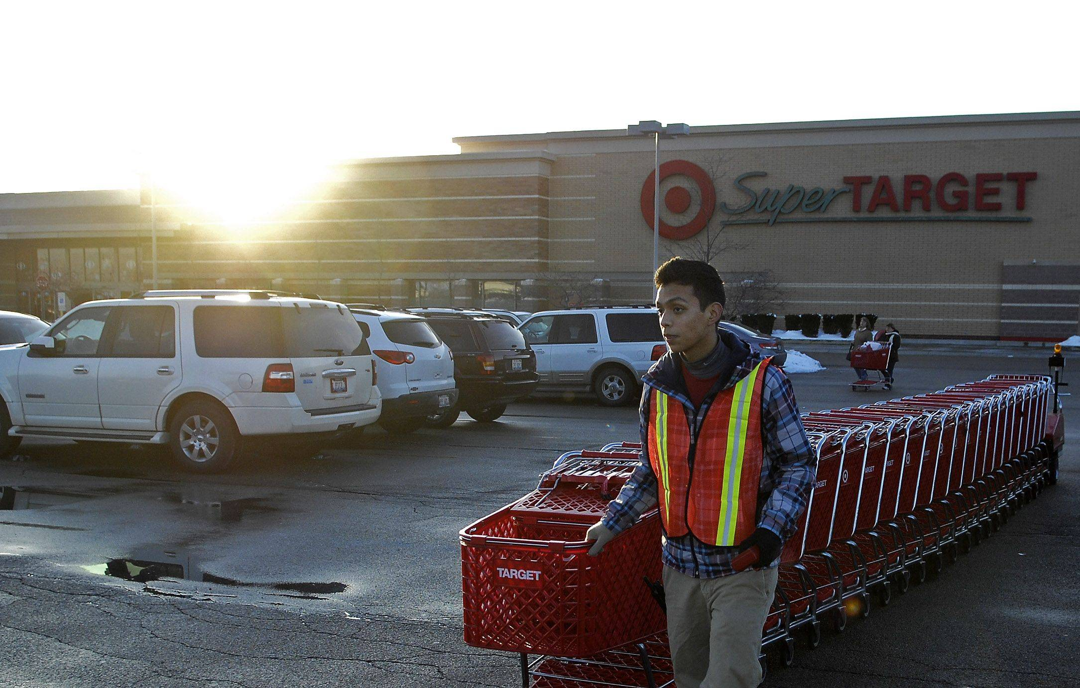 Sal Vargas says Under Armour helps while collecting shopping carts at the Target in South Elgin.