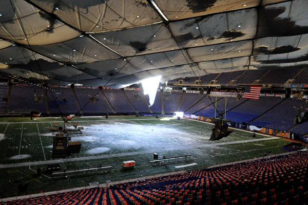 The collapsed roof of the Metrodome can be seen from inside on Sunday. The inflatable roof collapsed after a snowstorm that dumped over 15 inches of snow on Minneapolis.