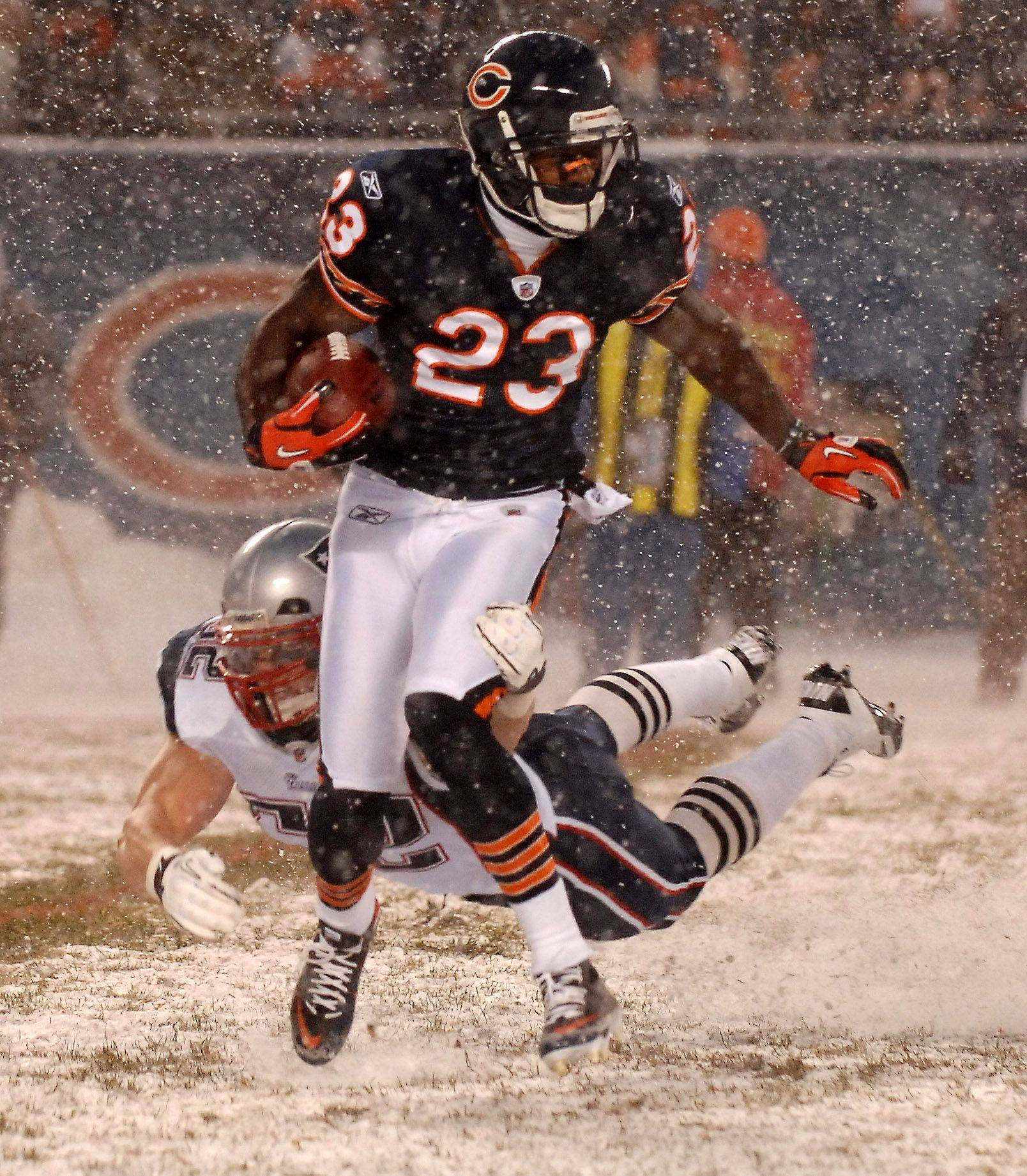 Chicago Bears kick returner Devin Hester breaks a tackle at Soldier Field.