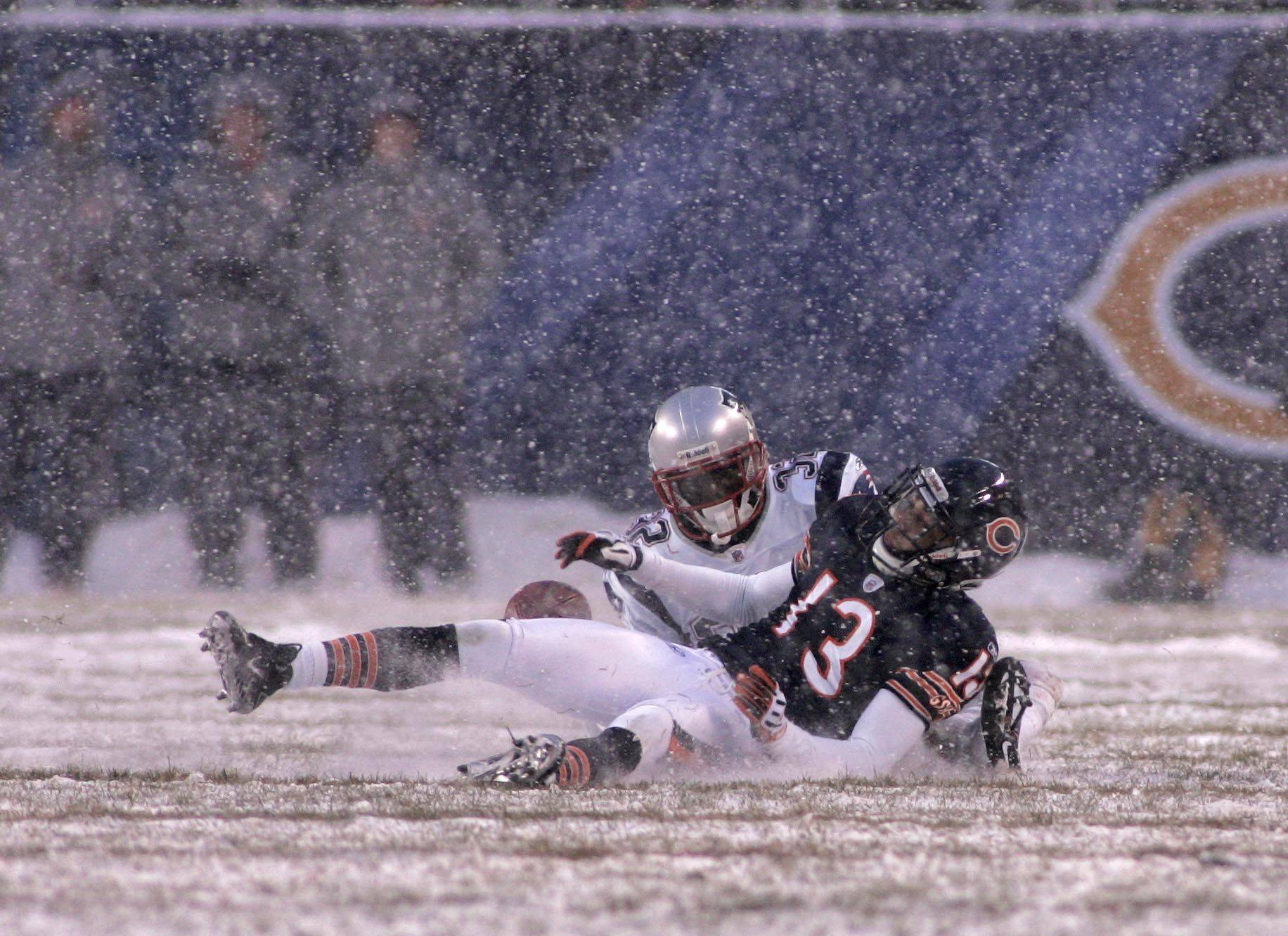 Chicago Bears wide receiver Johnny Knox rolls on the ground after fumbling a pass in the second quarter. New England Patriots safety Brandon Meriweather caused the fumble which resulted in a Patriot touchdown.