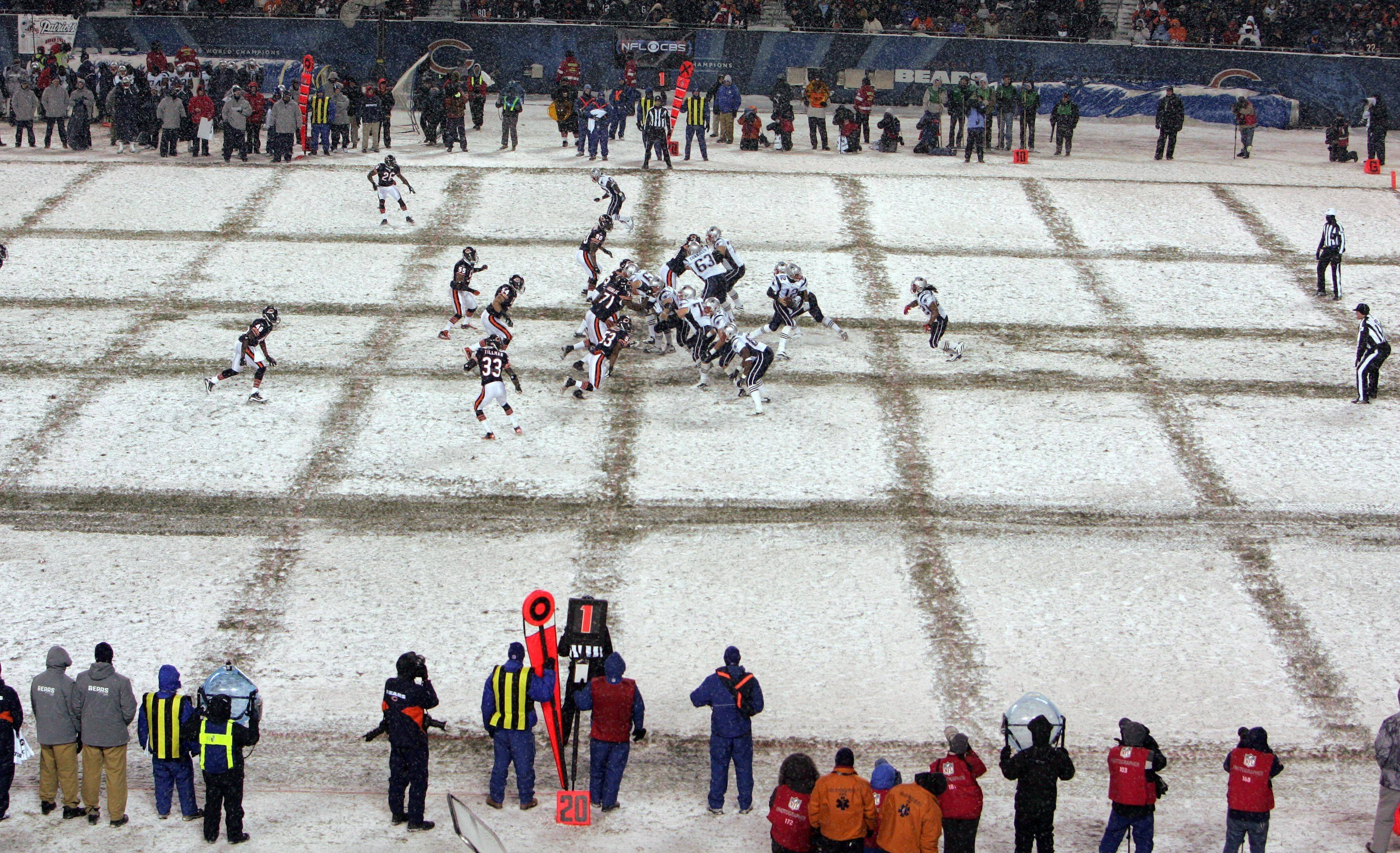 Snow made play difficult between the Chicago Bears and the New England Patriots at Soldier Field.