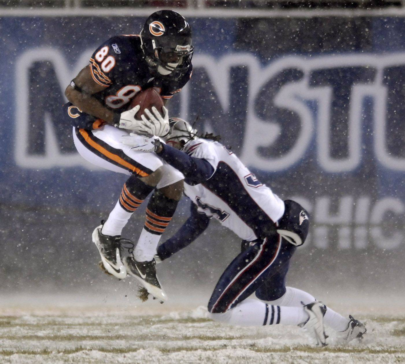 Chicago Bears wide receiver Earl Bennett hauls in a long fourth quarter reception in front of New England Patriots safety Brandon Meriweather.