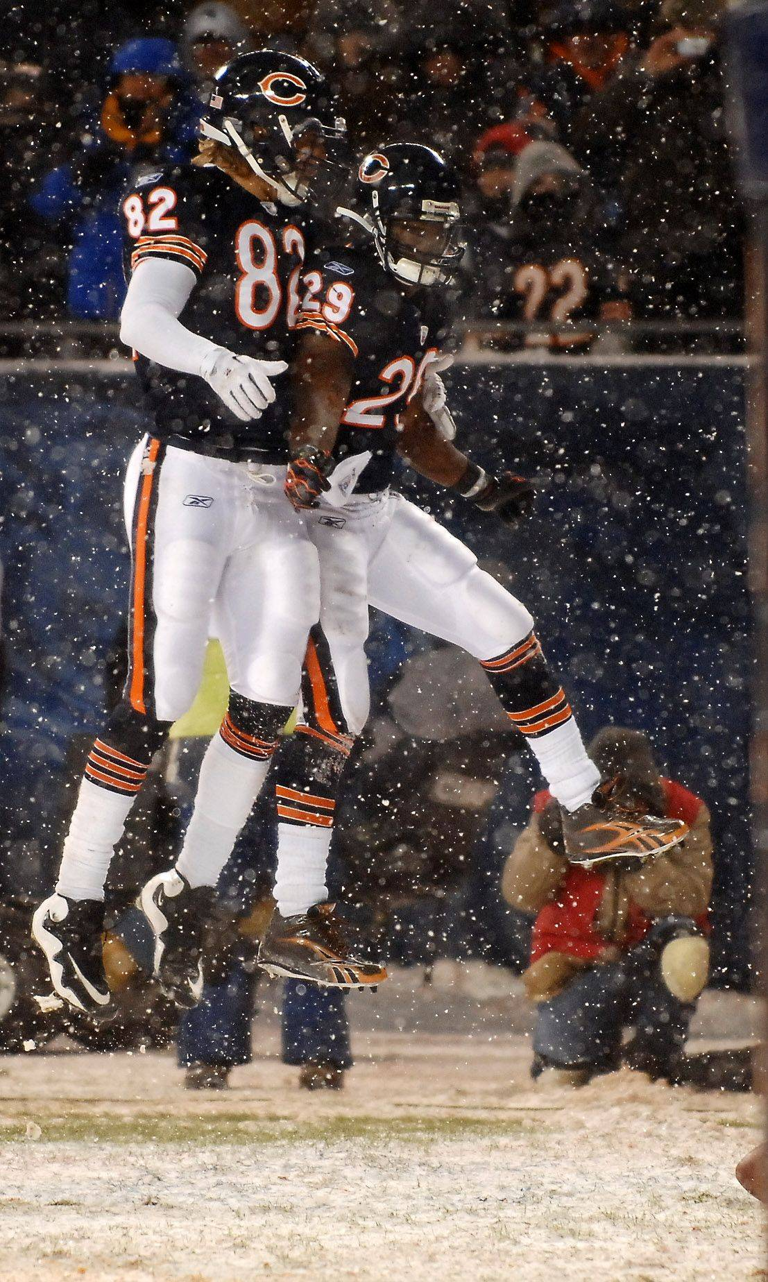 Chicago Bears tight end Greg Olsen and running back Chester Taylor celebrate Taylor's short touchdown run.