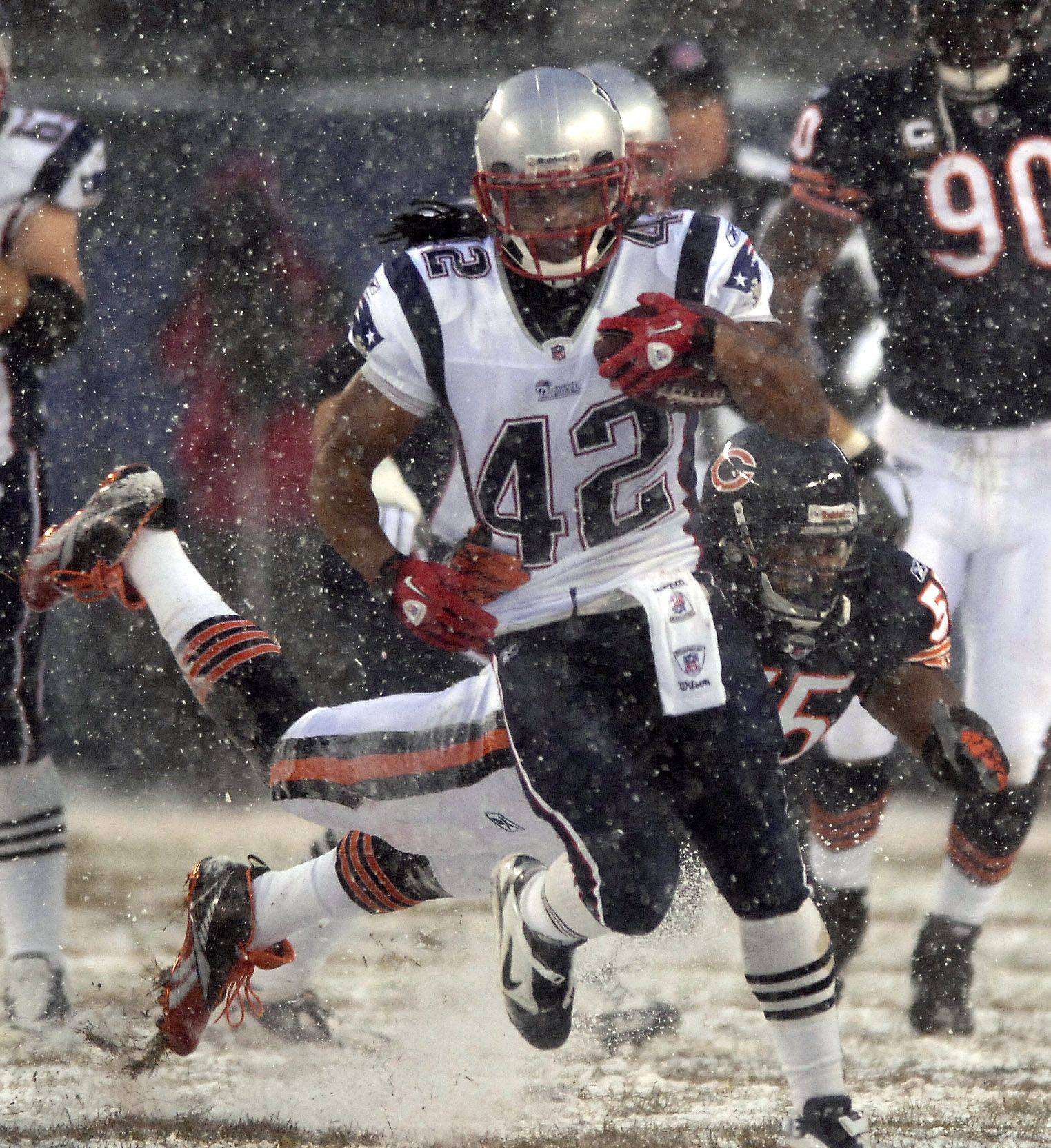New England Patriots running back BenJarvus Green-Ellis runs past a diving Lance Briggs.