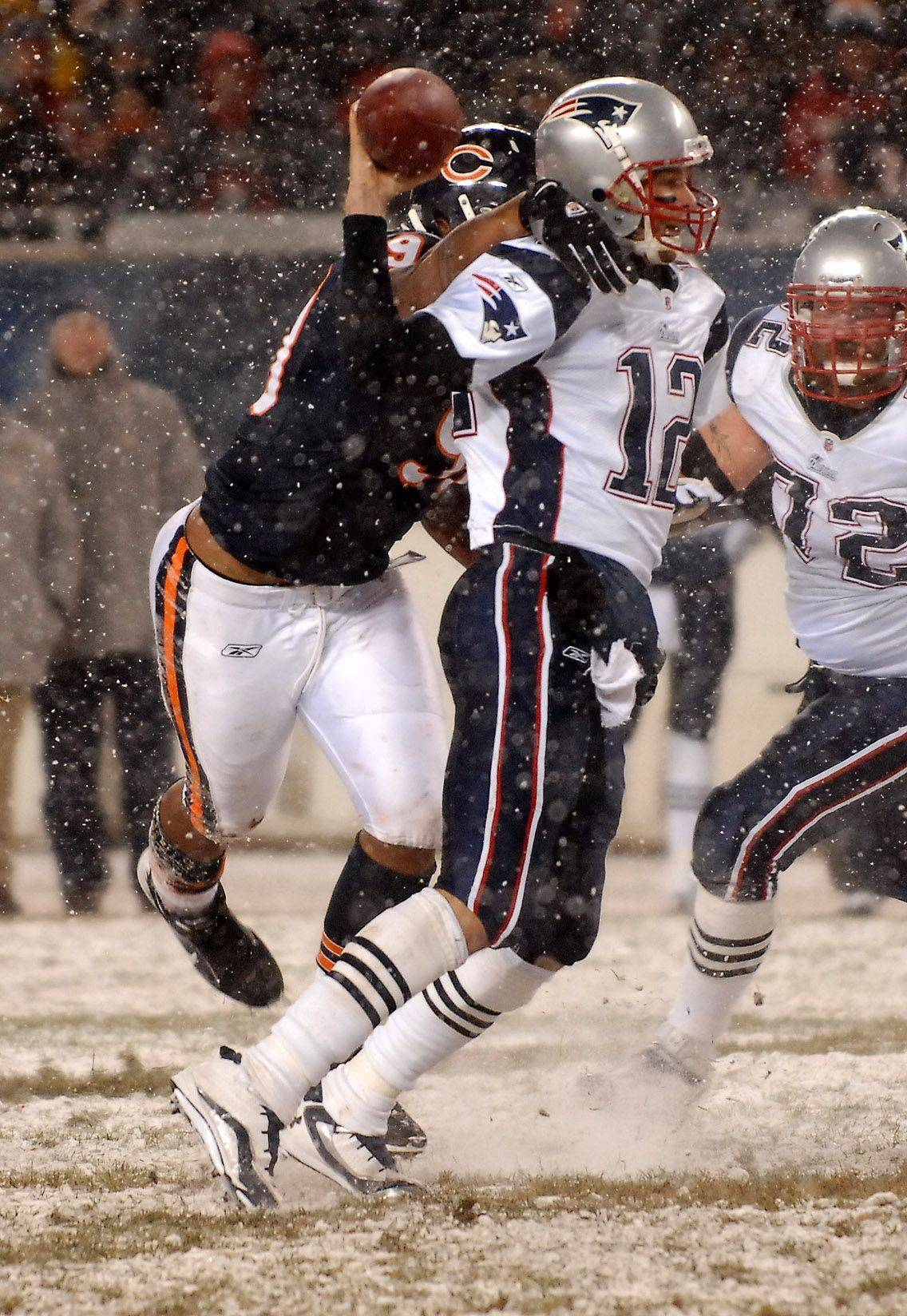 Chicago Bears defensive end Julius Peppers sacks New England Patriots quarterback Tom Brady.