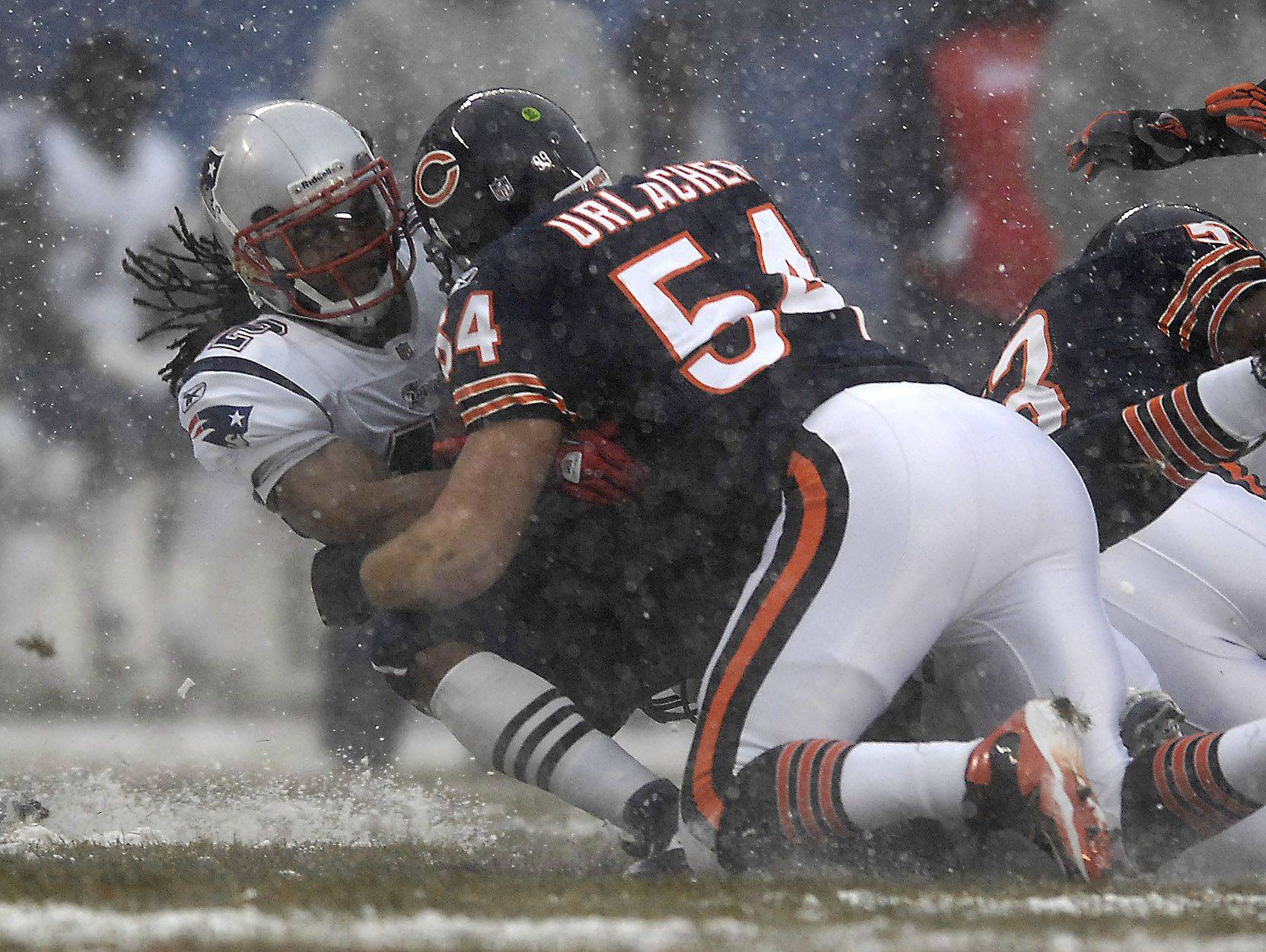 Chicago Bears linebacker Brian Urlacher tackles New England Patriots running back BenJarvus Green-Ellis.