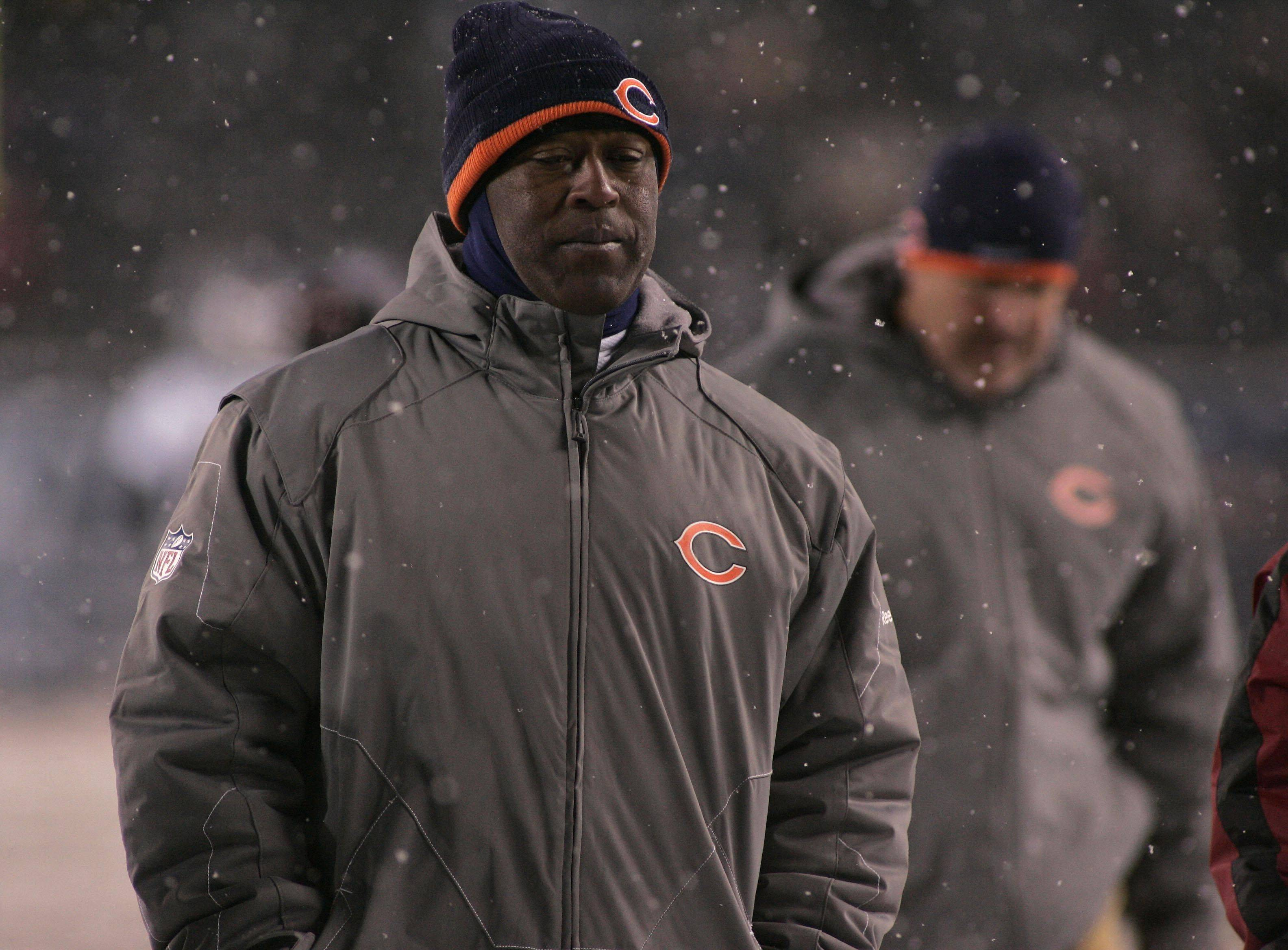 Chicago Bears coach Lovie Smith walks off the field after the Bears loss to the Patriots.