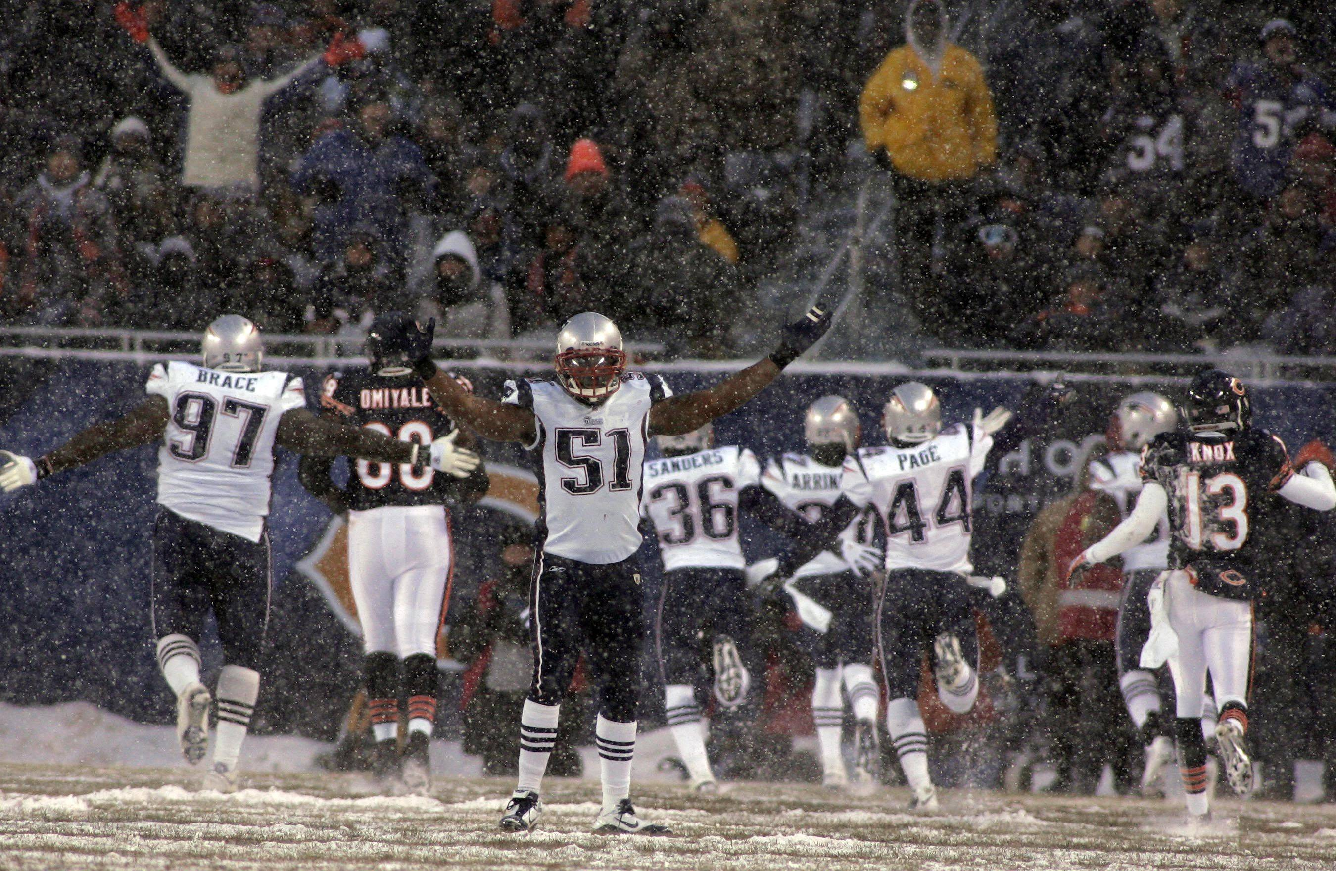 New England Patriots linebacker Jerod Mayo celebrates after an interception in the second quarter turned into a touchdown.