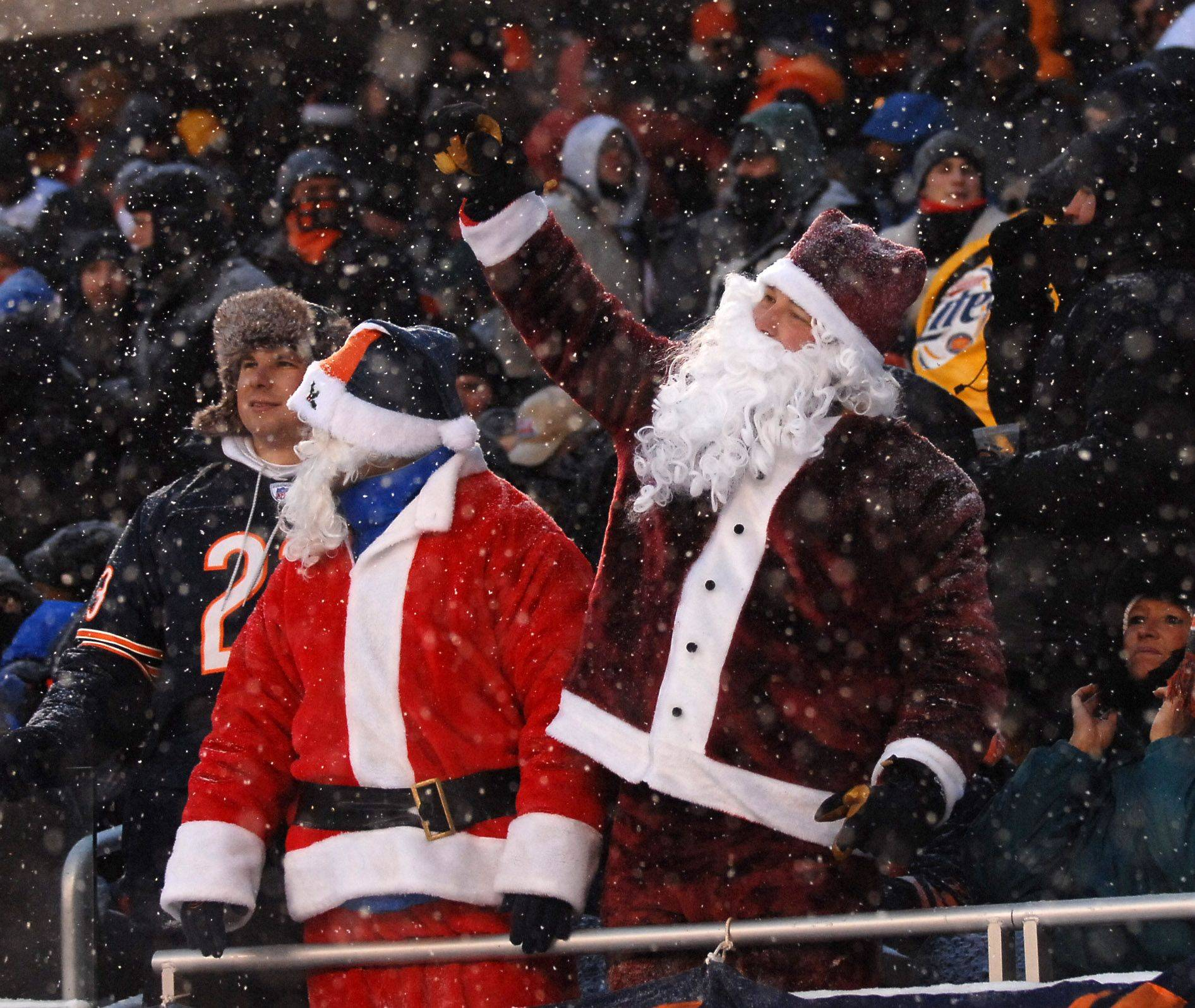 Two of the many Santas in attendance during Sunday's game between the Chicago Bears and the New England Patriots at Soldier Field.