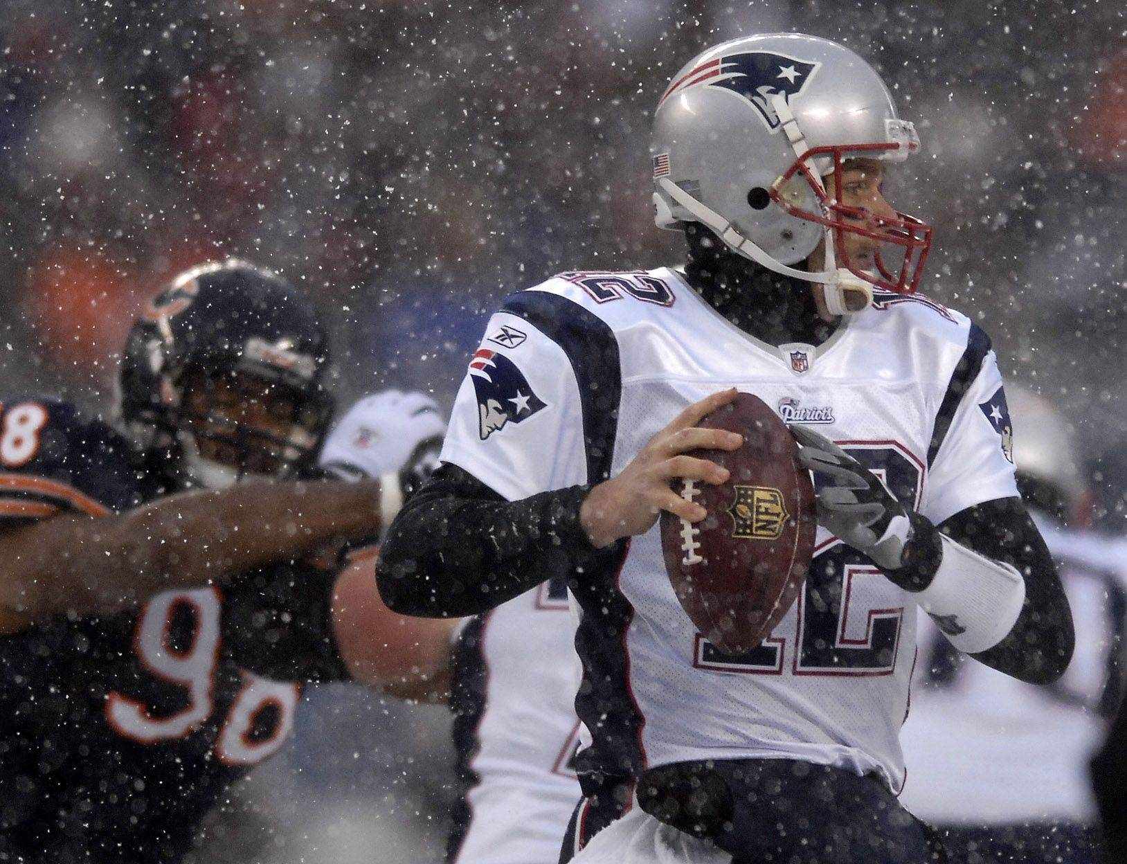 New England Patriots quarterback Tom Brady looks to pass.