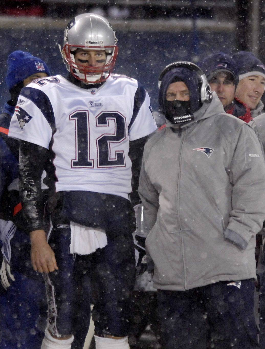 New England Patriots quarterback Tom Brady talks with head coach Bill Belichick.