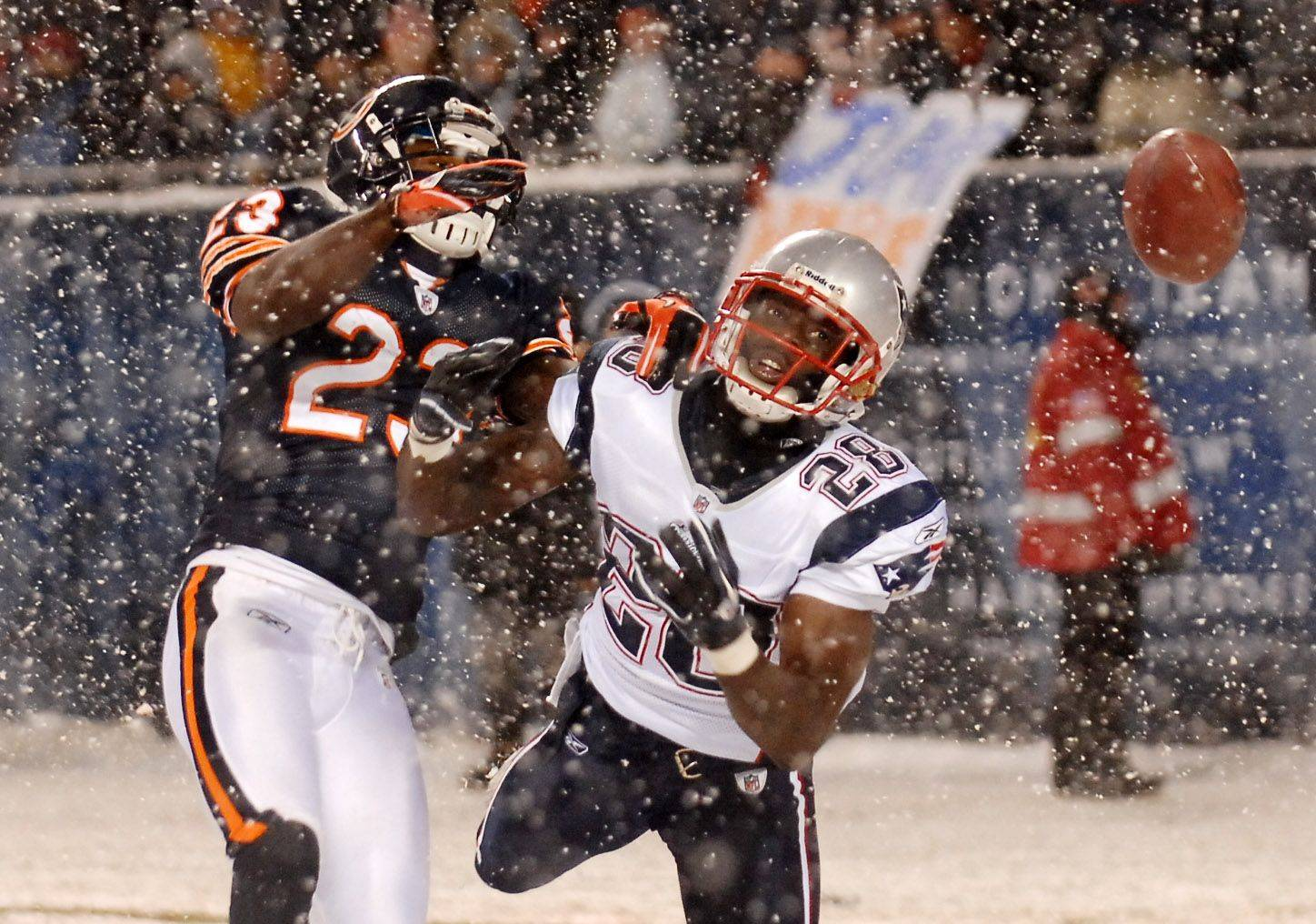 New England Patriots cornerback Darius Butler breaks up a pass intended for Chicago Bears wide receiver Devin Hester.