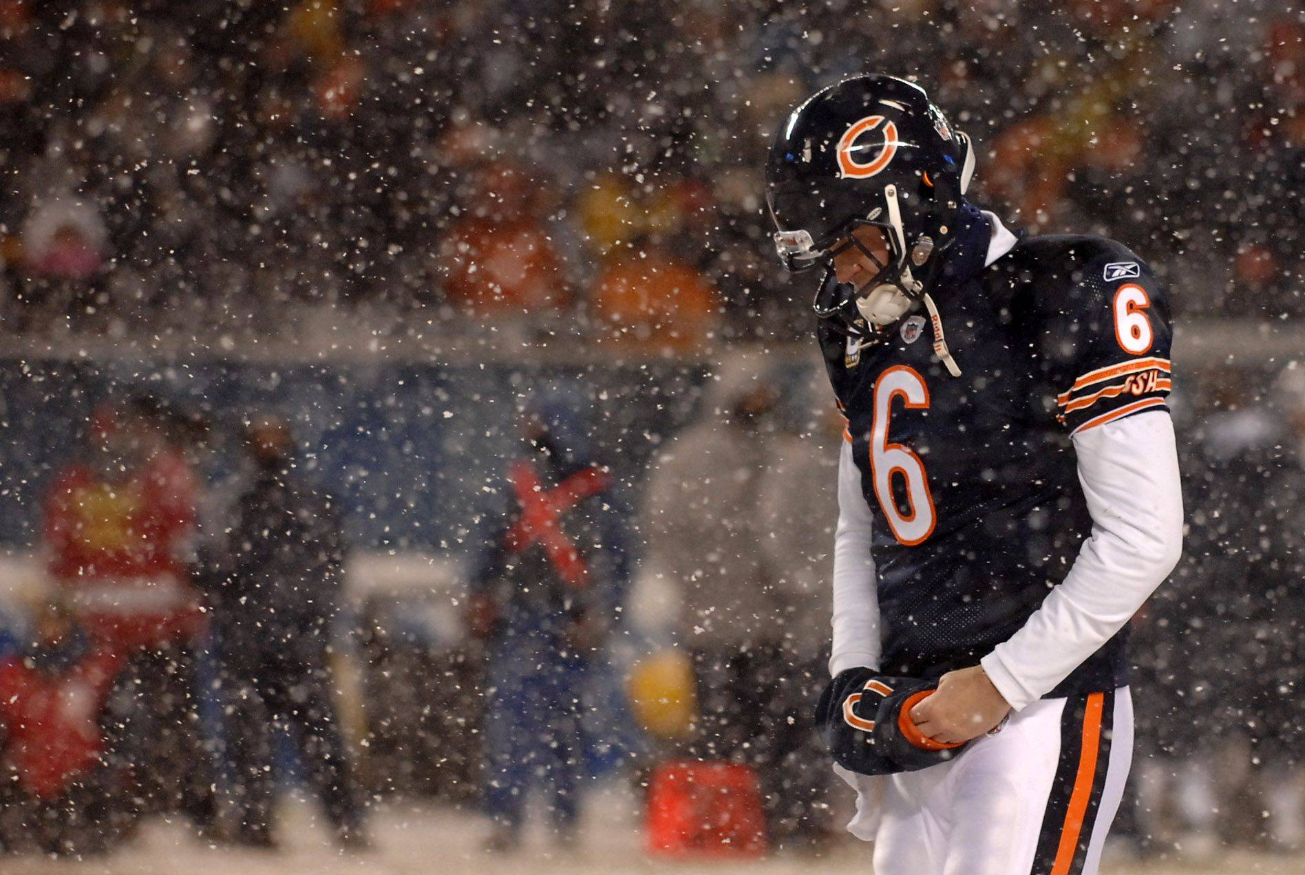 Chicago Bears quarterback Jay Cutler walks off the field after a change of possession.