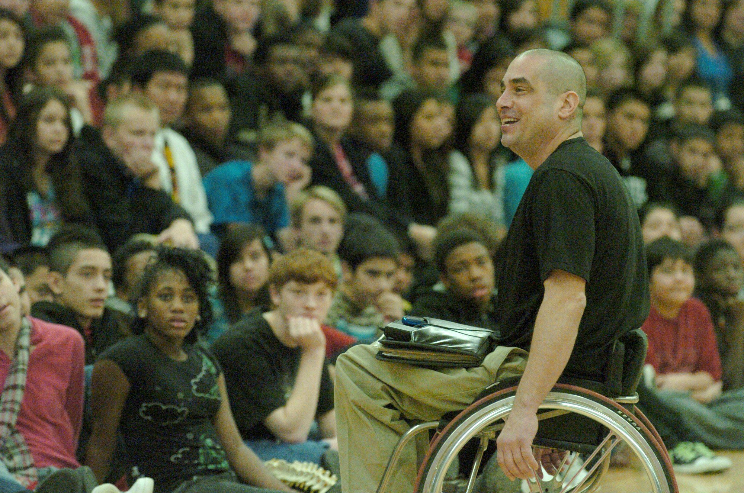 Former gang member James Lilly speaks to the students at Carpentersville Middle School Thursday afternoon about turning his life around. Lilly became paralyzed from the waist down after a gang shooting.