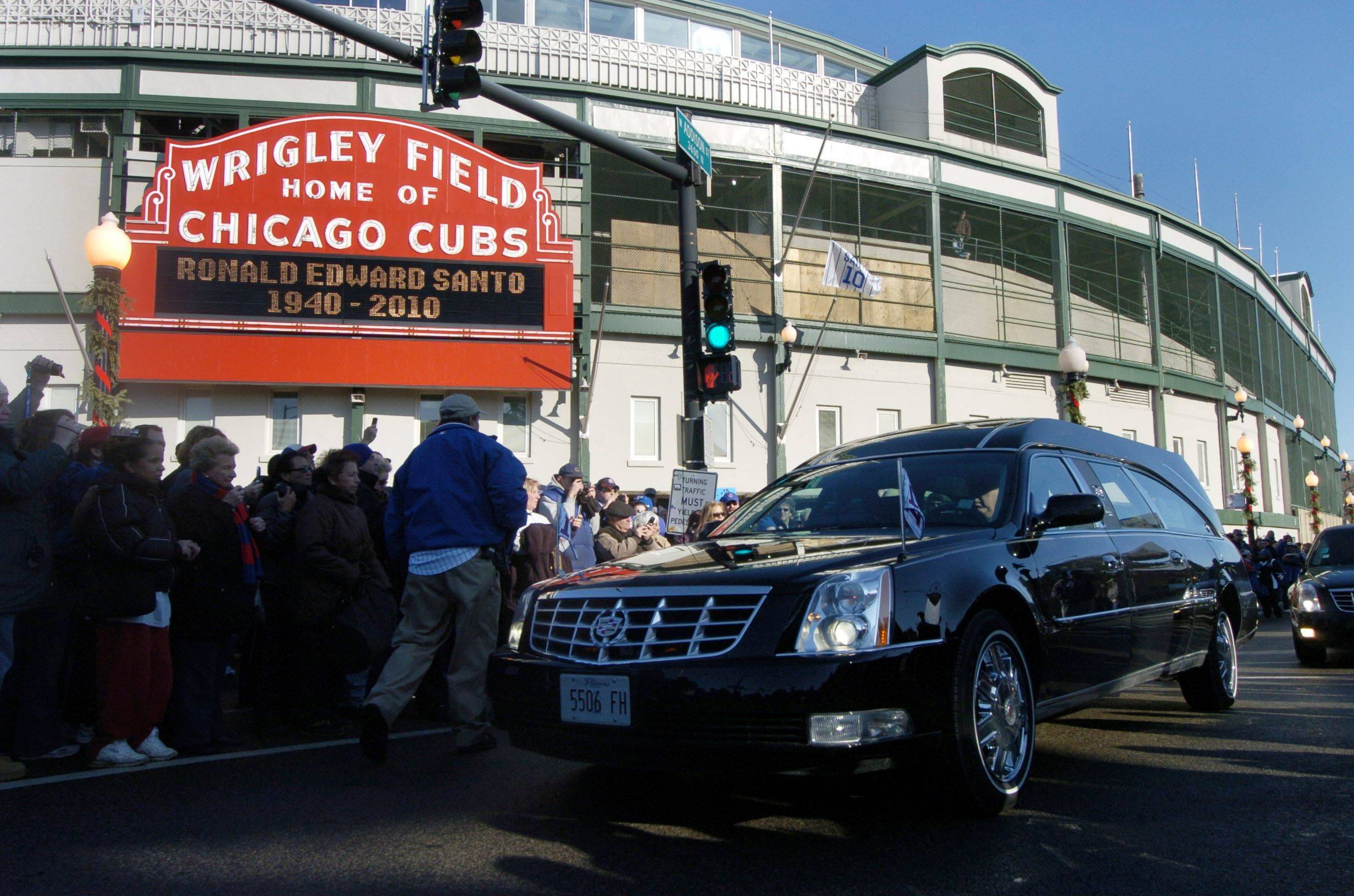Chicago Cubs great and broadcaster Ron Santo's funeral procession pauses in front of Wrigley Field Friday.