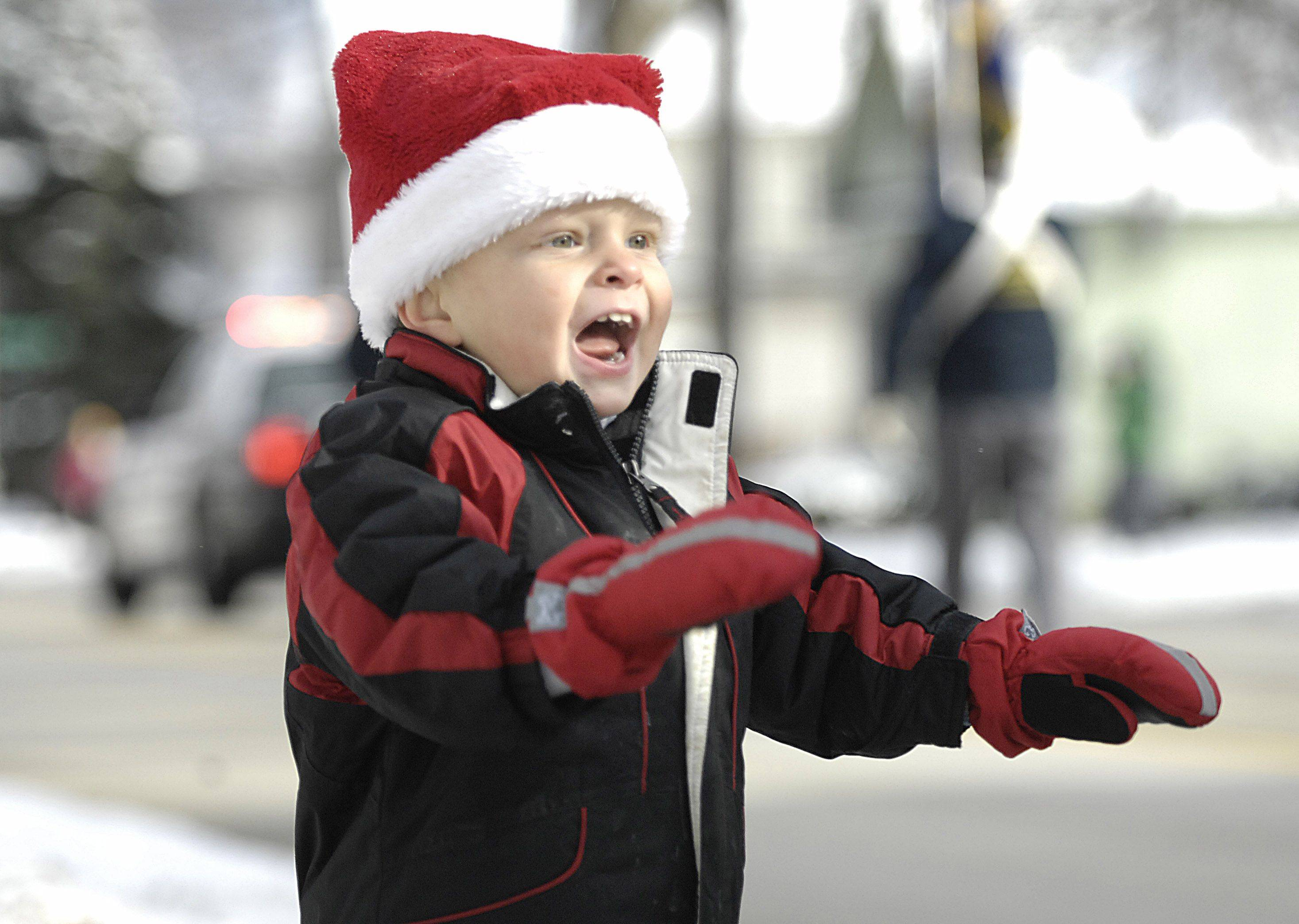 Keegan Brennen, 2, wears his Christmas hat as he jumps and screams for candy at Sunday's Merry Cary Holiday Parade in downtown Cary. He was with his mom Lisa of Cary.