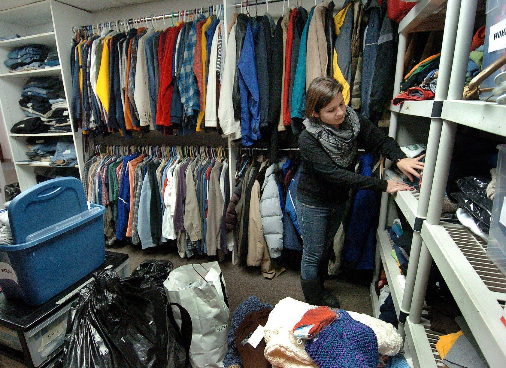 Vocational Assistant Corey Keller sorts through the clothing closet at the PADS shelter in Palatine.