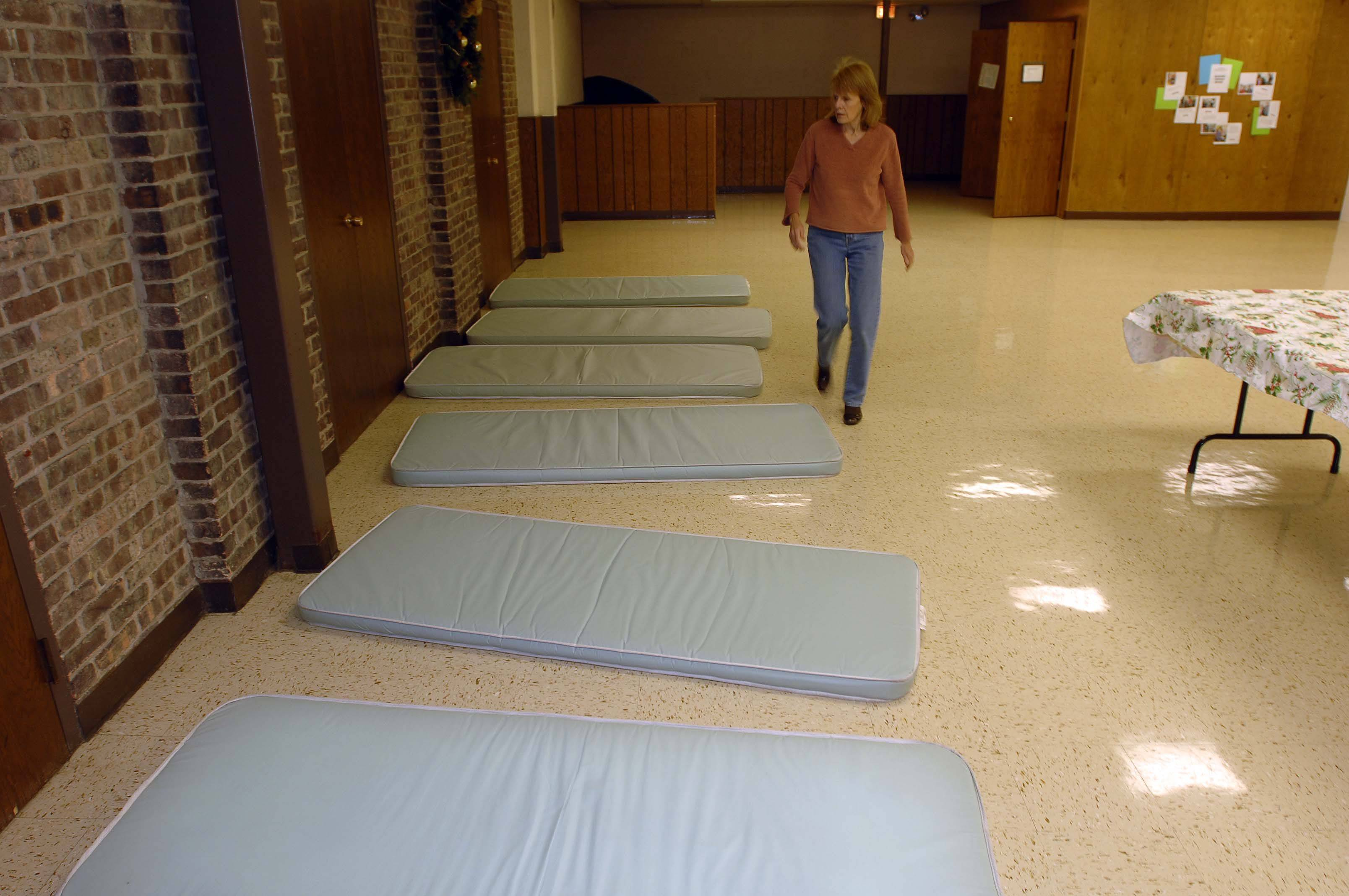 Sleeping pads line the floor at the PADS shelter at First Congregational Church in Naperville Wednesday.
