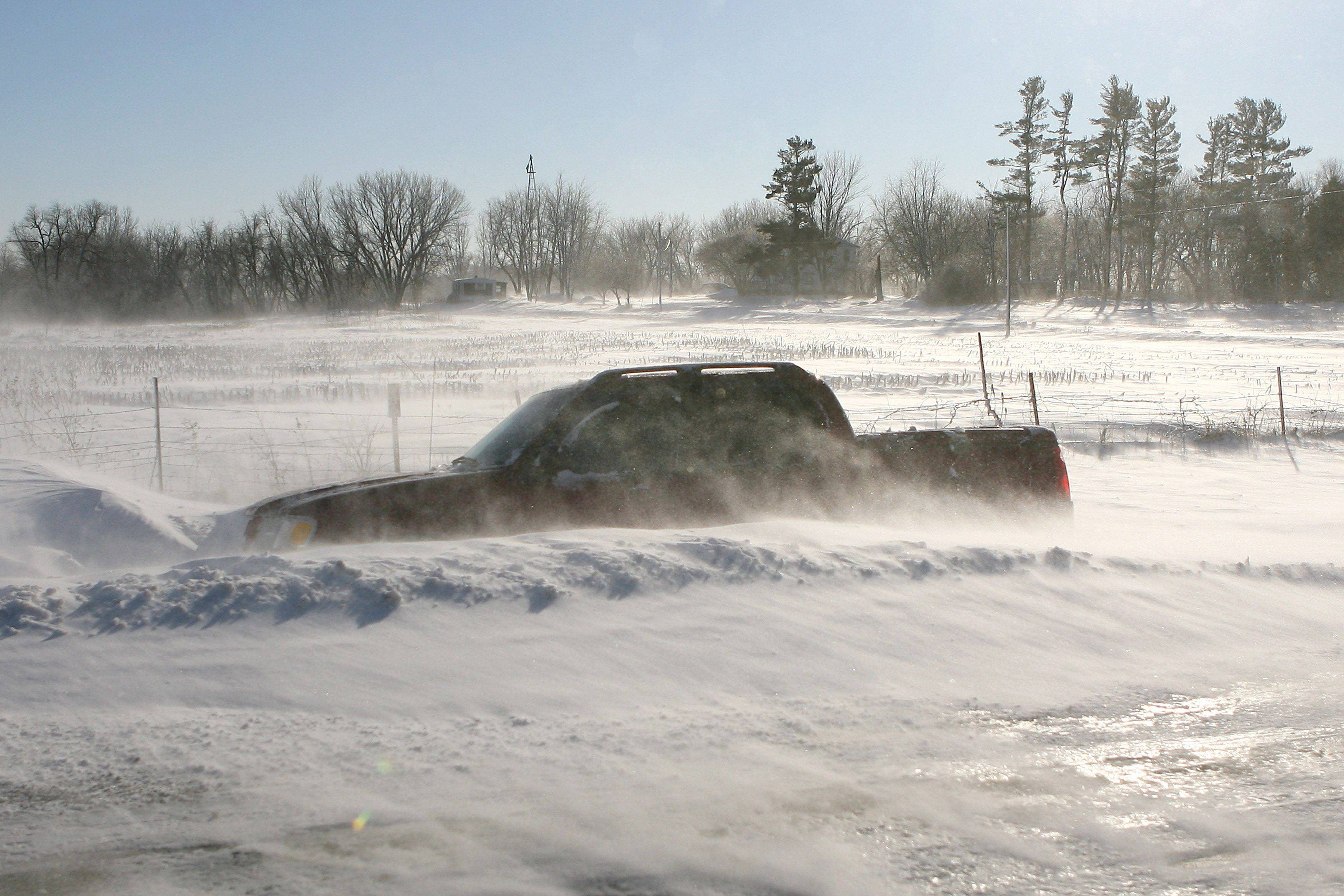 Cars throughout the Midwest were stranded in their cars as winter storms dumped several inches of snow and high winds caused high drifts, making some roads impassable.